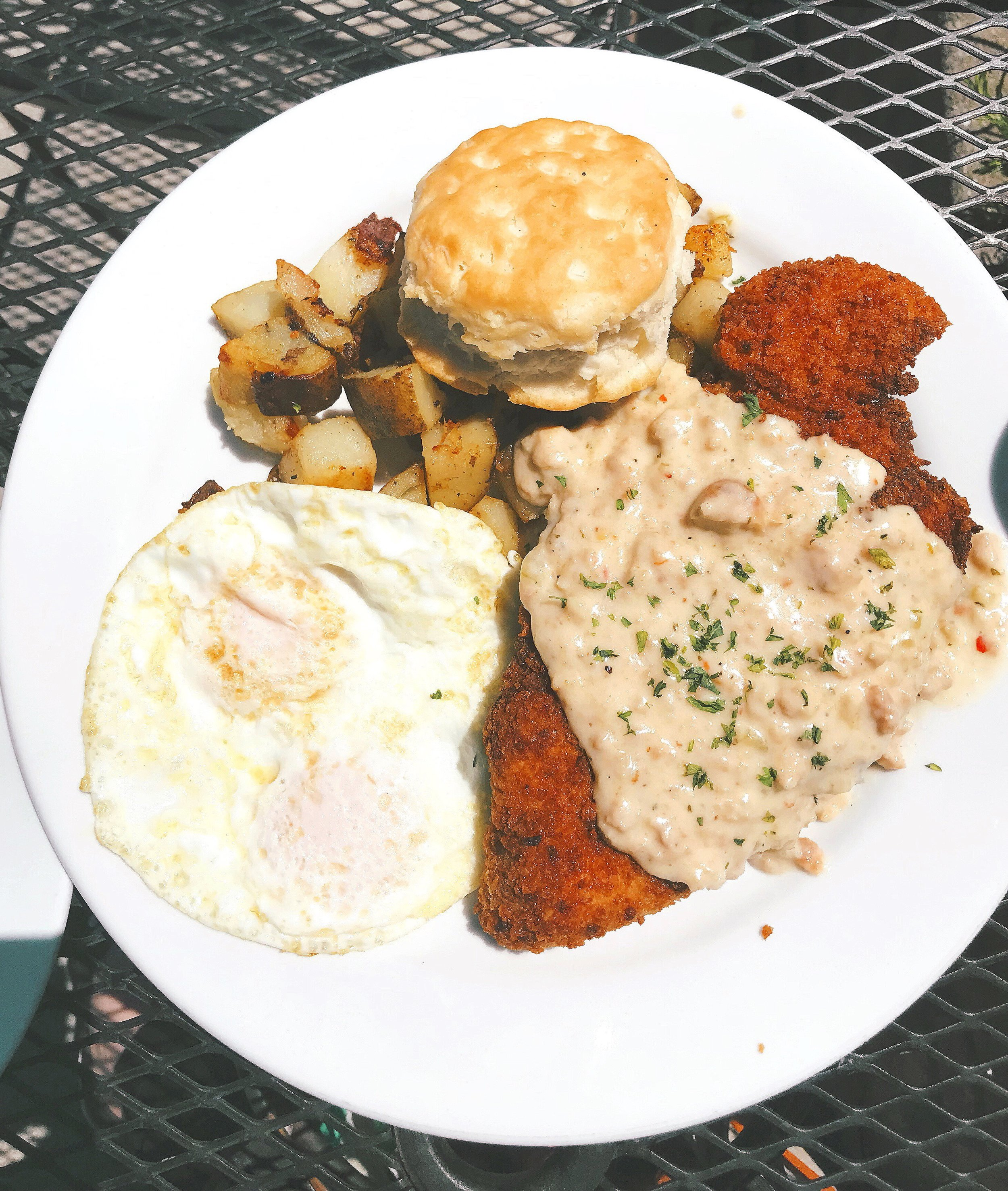 Alec's Go-to Order: Fried Chicken with 2 eggs any style, Gravy, and a Biscuit