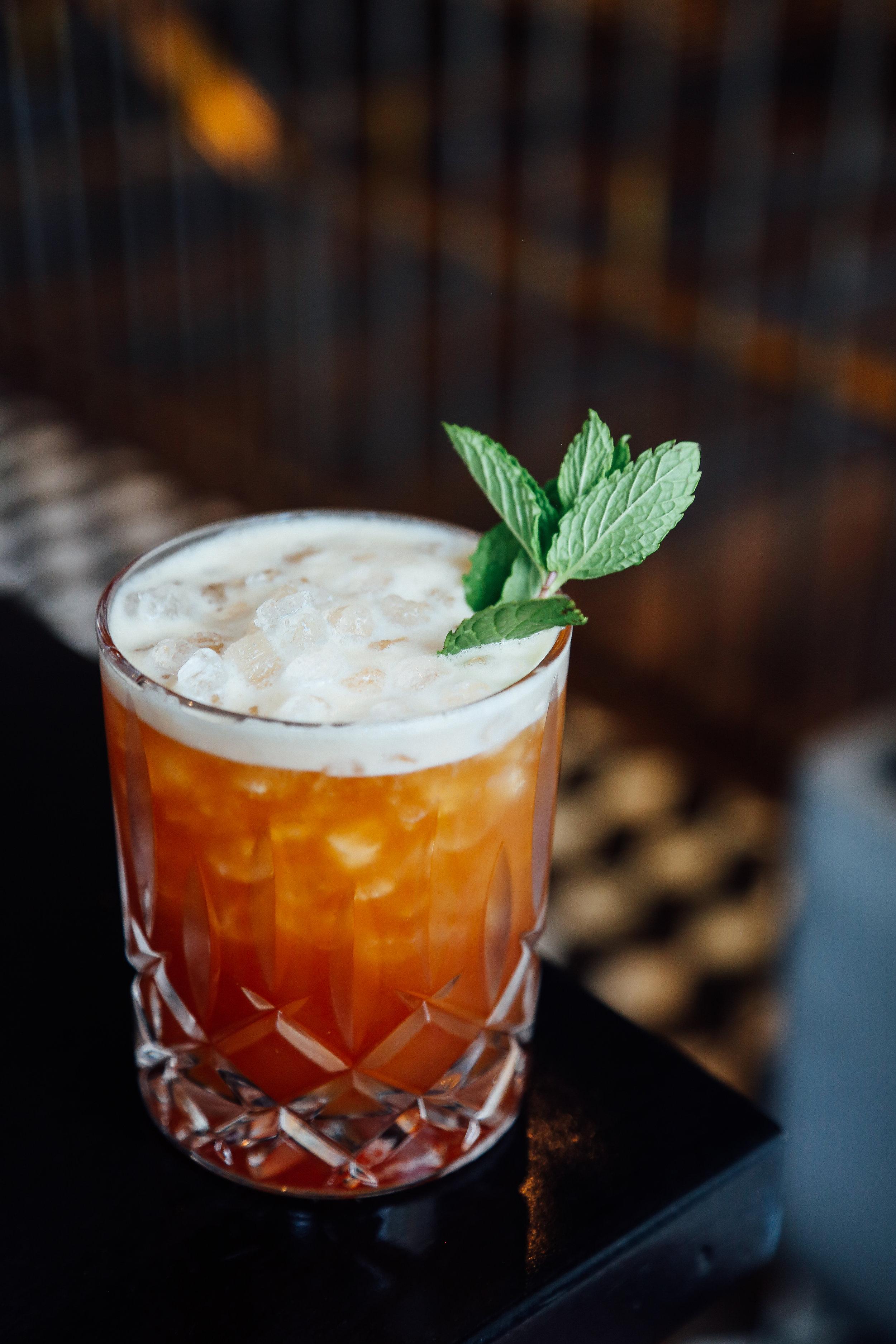 iI Sole Mattutino - Meletti, Gold Rum, Campari, Pineapple, lime, cold brew, mint