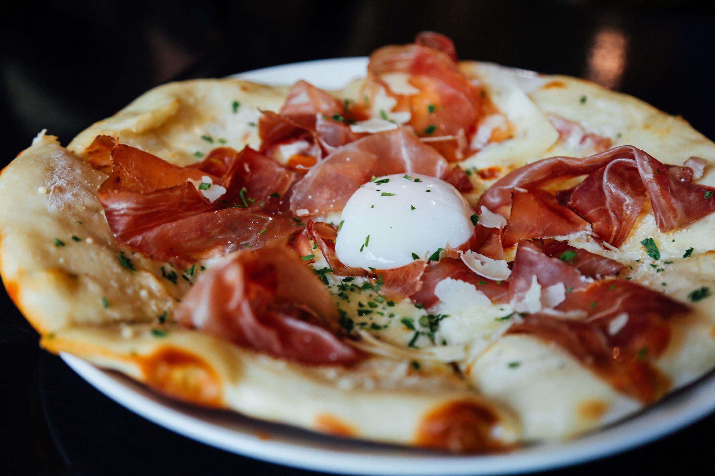 Breakfast Pizza - speck, pancetta cream, parsley, 63 degree egg, shaved parmesan