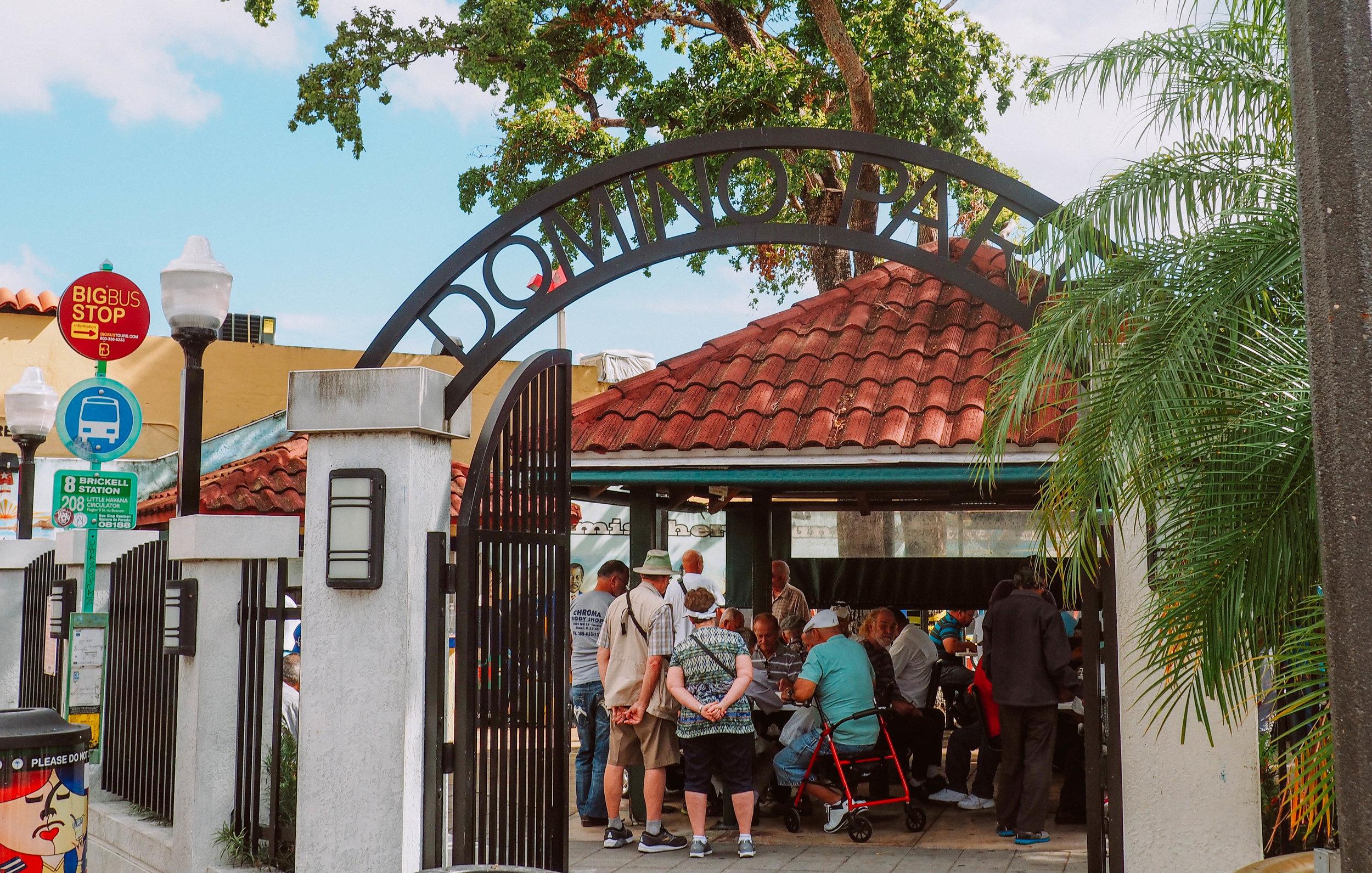 Locals and tourists at Domino Park, Little Havana, Miami, FL.