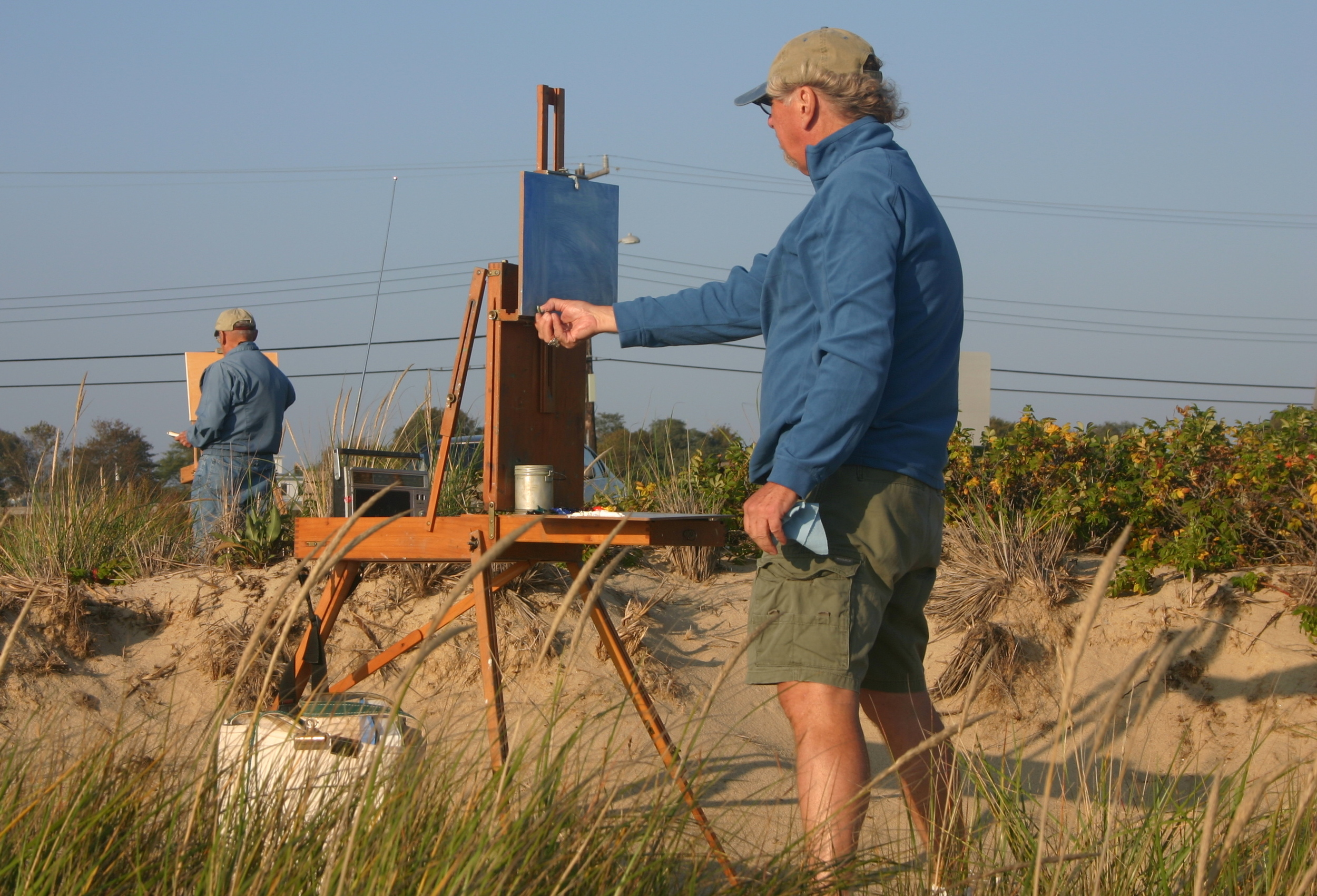 Earl Blust, pictured here on the left, painting on Cape Cod at Wellfleet with fellow Seven Lively Artist David R. Henry.