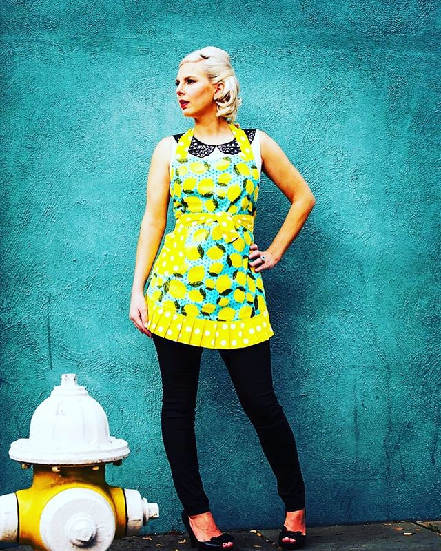 One of my all time favorite shots of our Lemon Apron. I love taking something so utilitarian (apron) and rocking it in a fashion photoshoot. Picking up the turquoise blue on a building in Charleston, with the pop of yellow from the fire hydrant not to mention the Mad Men sexy look of @amykopenkassis done by @pinkdotbeautybar Pure magic✨ . . . . #charleston #simplywhimsical #shopsimplywhimsical #design #kitchen #accessories #retro #lemons #home #picoftheday #wednesday #ilovecharlestonsc #photooftheday #create