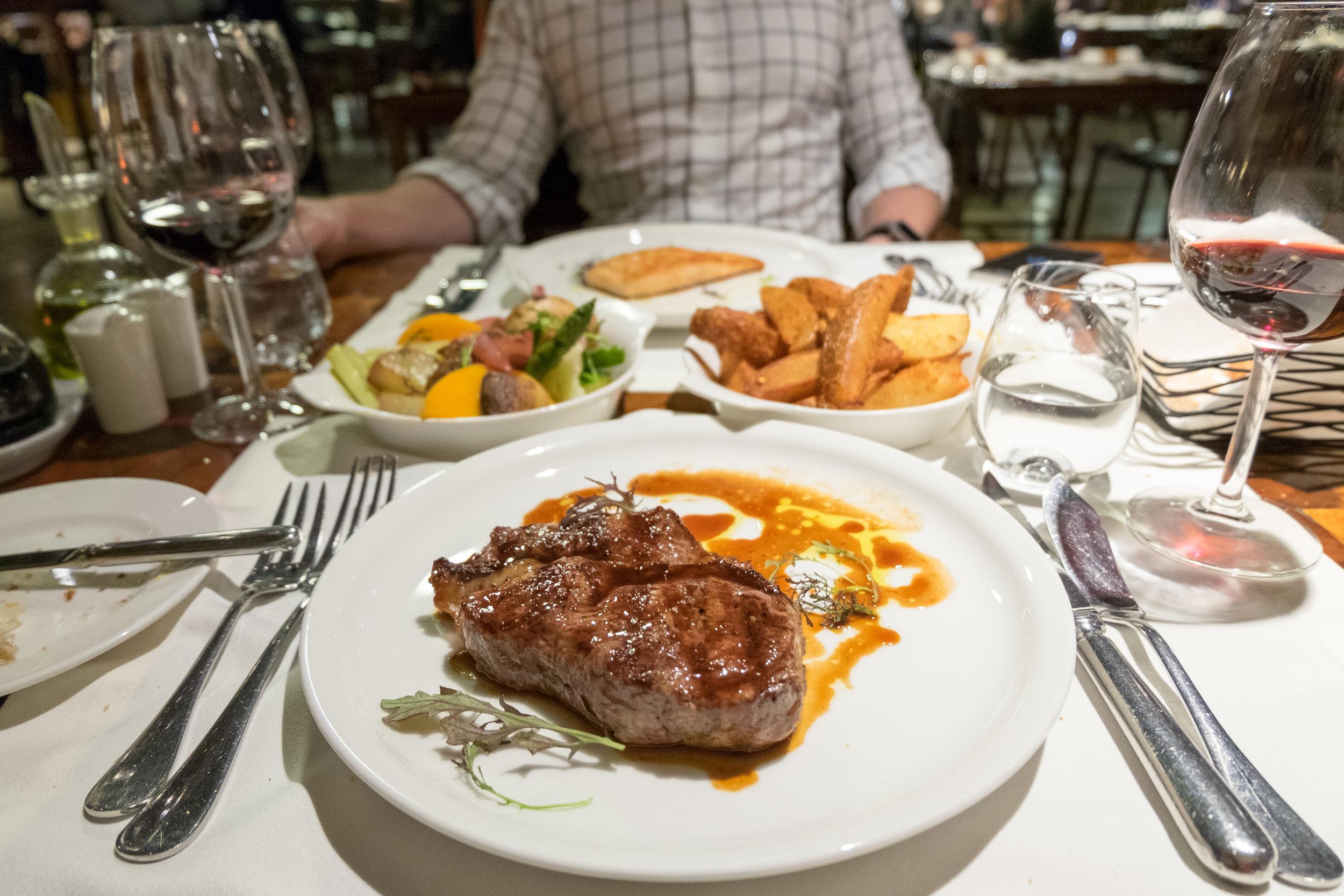 Patagonian steak with papas bravas