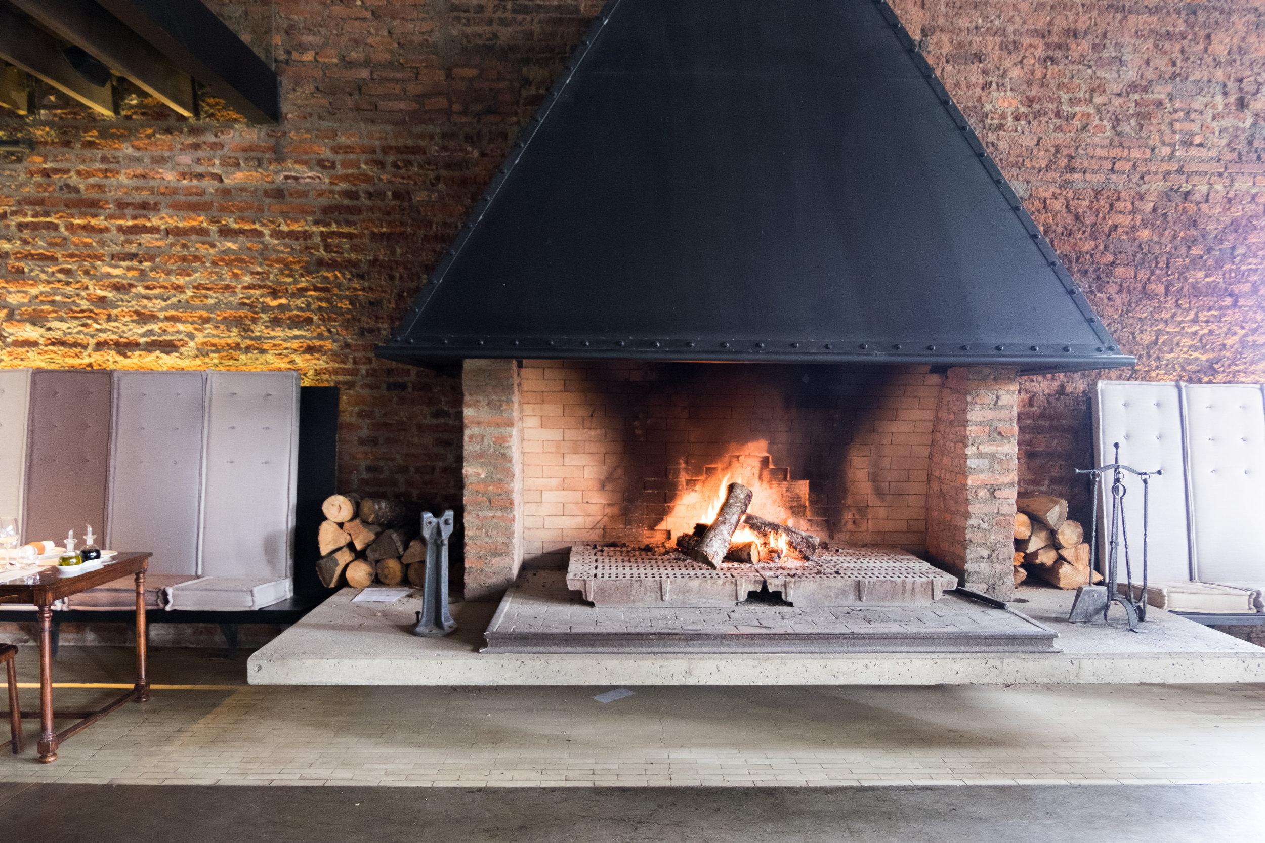 The fireplace in The Singular bar & restaurant