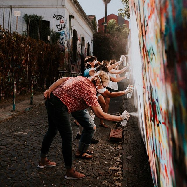 When our travelers arrive in Portugal, the very first thing they do is make their mark with @vanessateodoro in Lisbon. Can you think of a better way to bond with a bunch of women you just met?! We can't. ------------------------------------⠀ @wildterrains is a women-fueled travel company. We design awesome group trips that connect like-minded women around the world and we partner with local, women-owned businesses wherever we go.⠀ ------------------------------------⠀ 📷: @laurenlouisecollective⠀ #portugal #portugaltravel #visitportugal #streetart #streetarttour #graffitilesson #holiday #getaway #girlsgetaway #makeitlast #wearetravelgirls #explore #discovertheworld #destinations #passionfortravel #wanderlust #globetrotter #welivetoexplore #mytinyatlas#thatsdarling #liveauthentic #peoplescreative #visualcollective #beautifulmatters