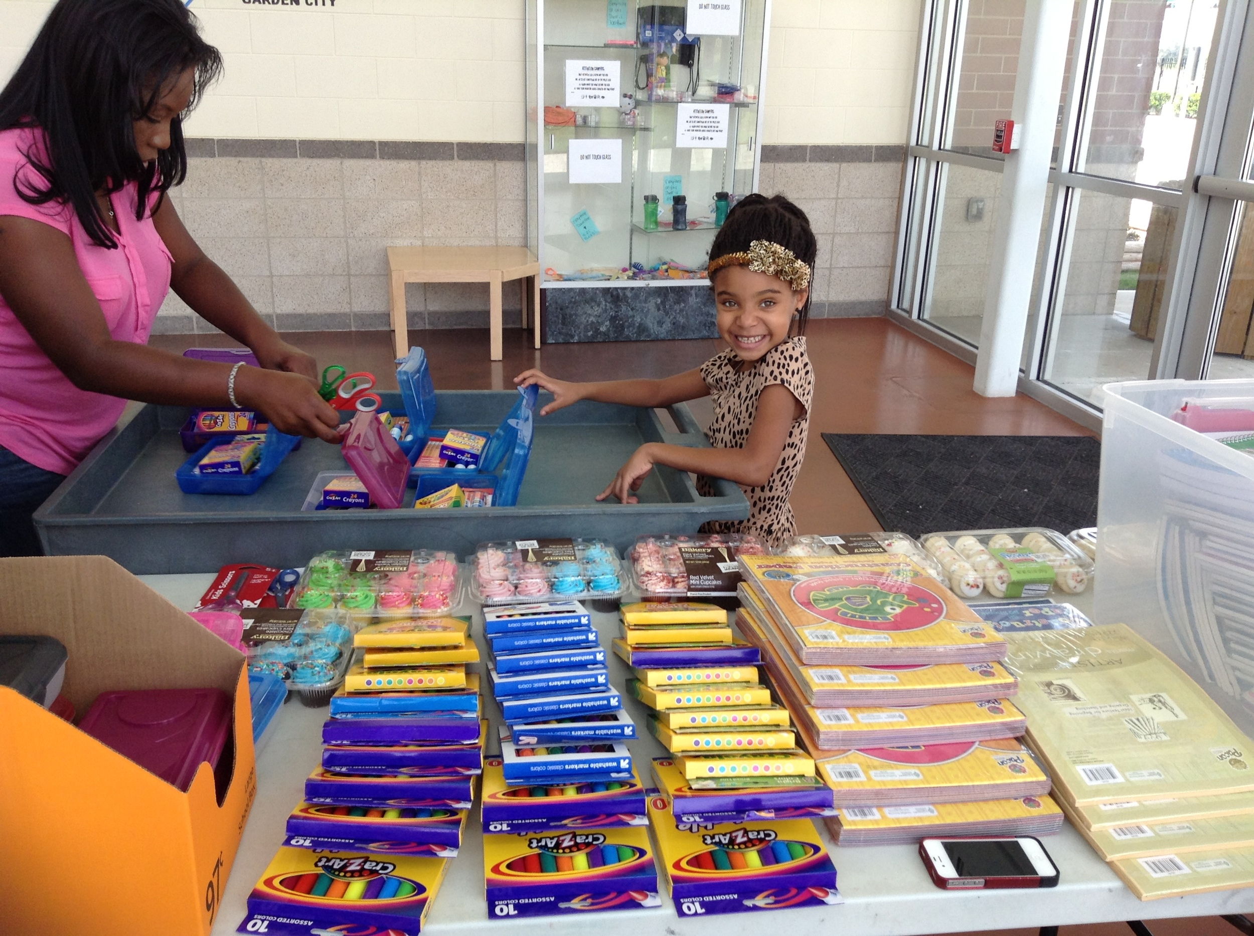 Saniya volunteers with local nonprofit organization, Diamond Footprints, Incorporated to donate school supplies to the children at a local Salvation Army - Boys & Girls Club.