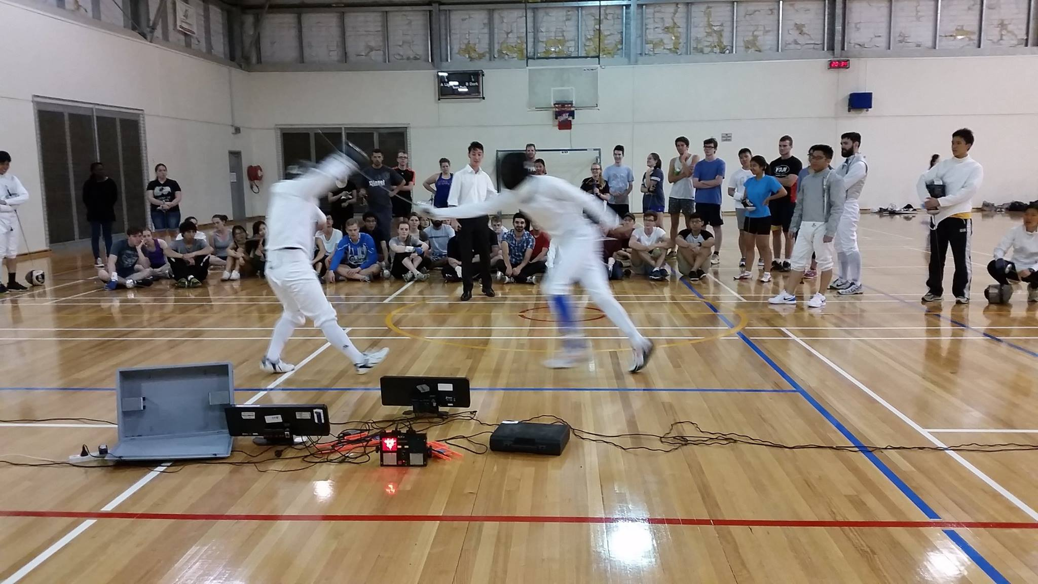The potential new club members watch a little epee demonstration