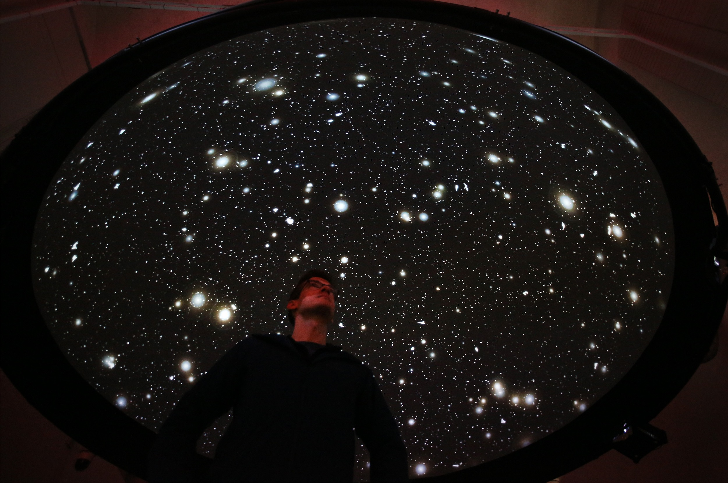 A visitor underneath the 'Black Shoals: Dark Matter'- a stock market planetarium created by Lise Autogena and Joshua Portway at the Big Bang Data exhibition at Somerset House on December 2, 2015 in London, England.  (Photo by Peter Macdiarmid/Getty Images for Somerset House)