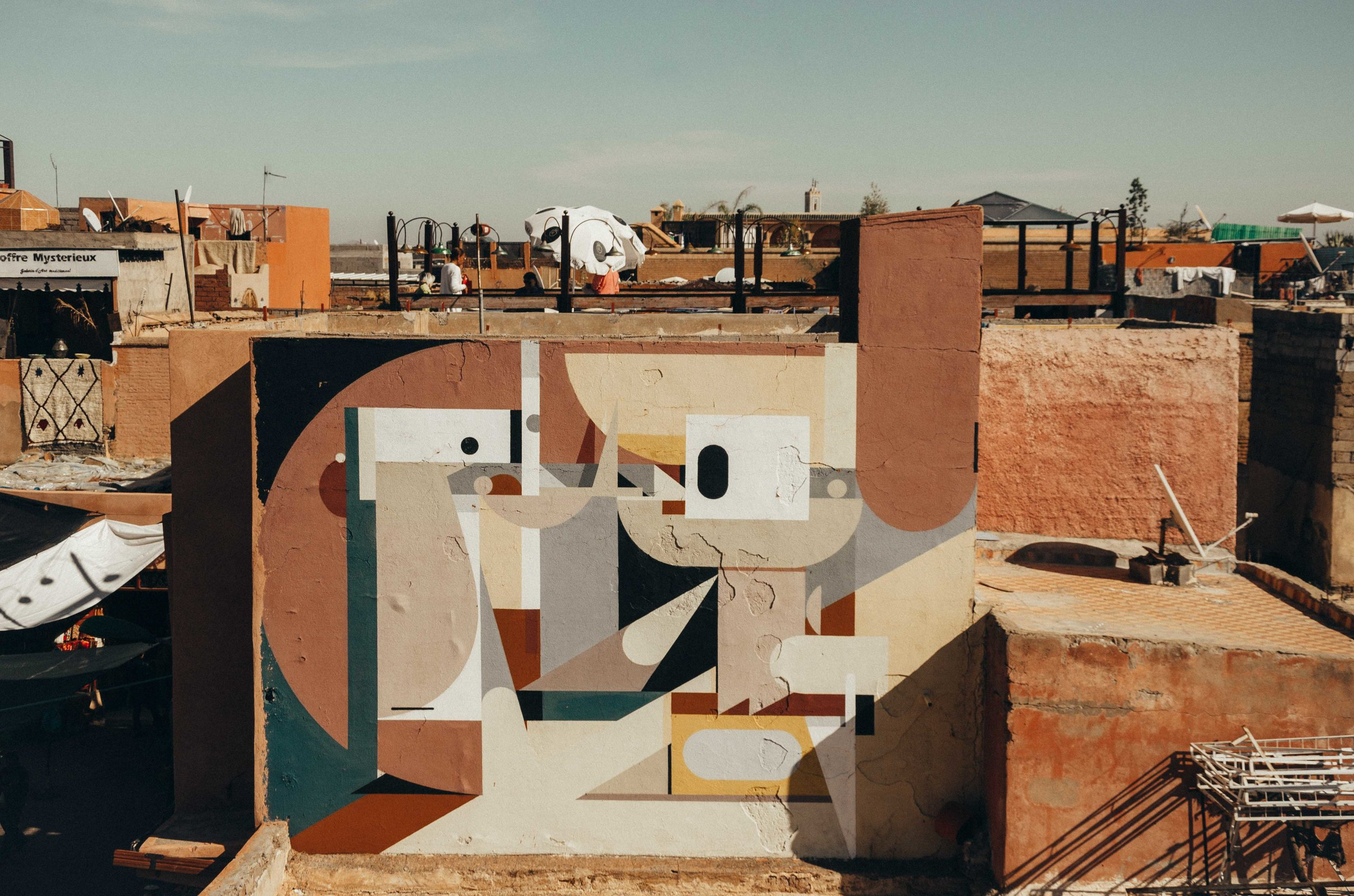 An unexpected piece of street art atop a rugged building in Marrakech. I like how the colours of the mural blend seamlessly with the environment!