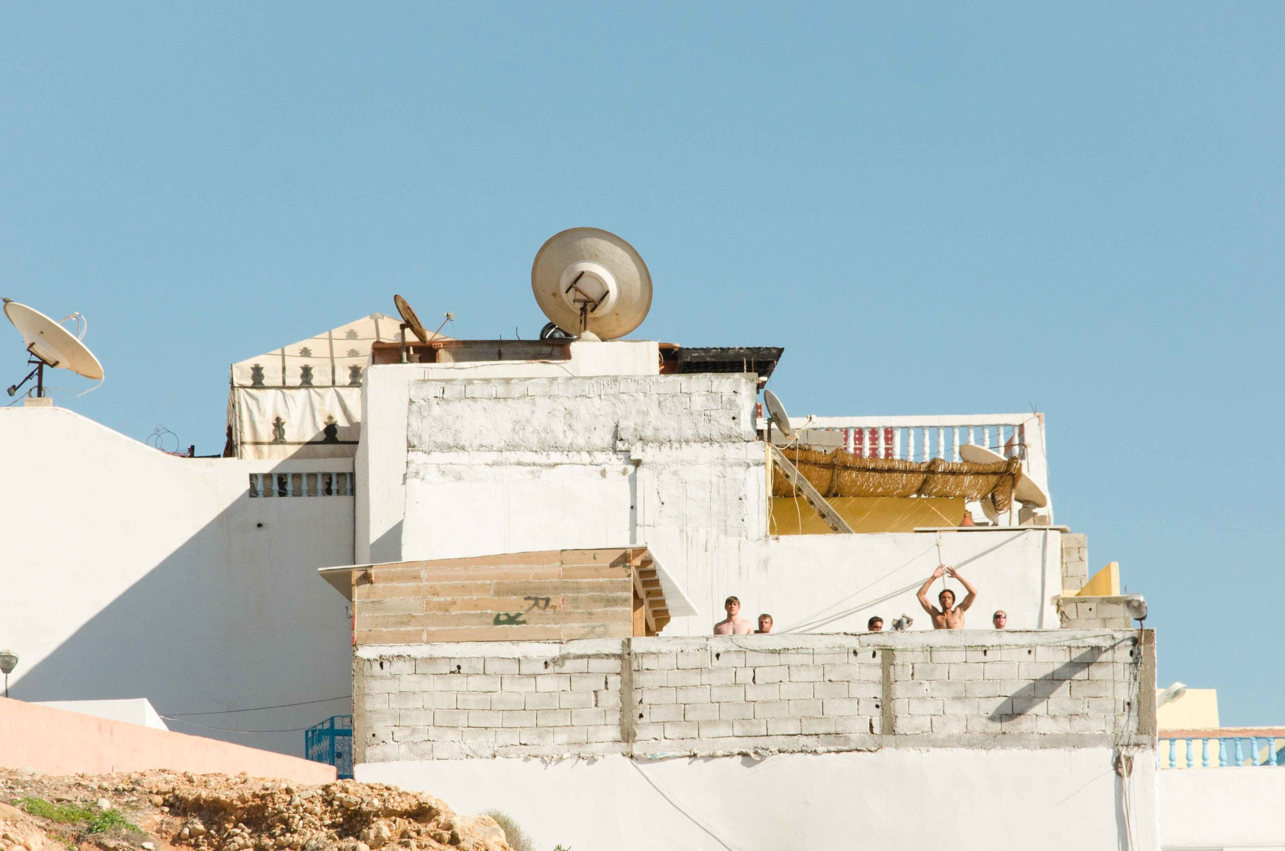 Shot in Morocco; I was having a stroll at the beach and the architecture caught my attention; upon a closer look, I noticed that there were a bunch of people exercising vigorously on the rooftop!