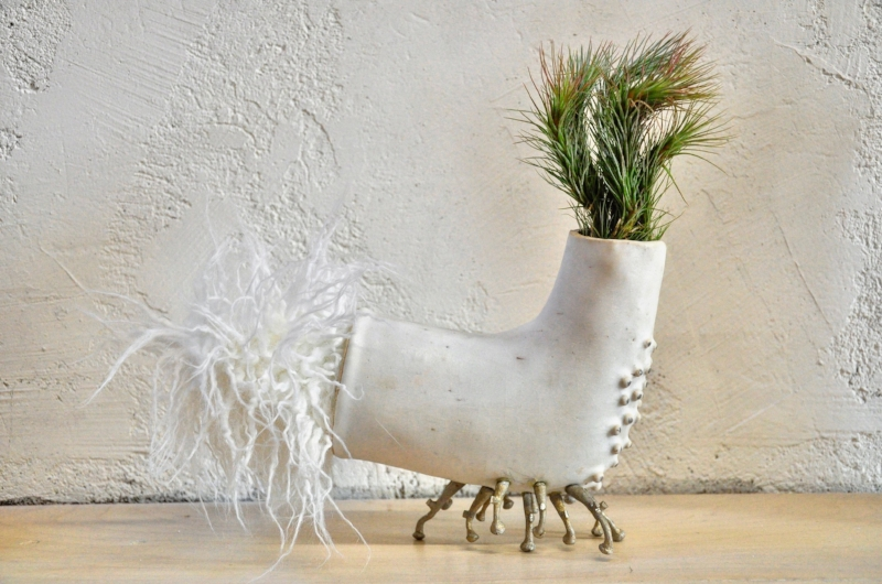 """This is Sybil. Ceramic, white gold, tillandsia, and mixed media. 10.5"""" h x 11"""" w x 7"""" d. $1,600. Spray plant with water twice per week.  SOLD"""