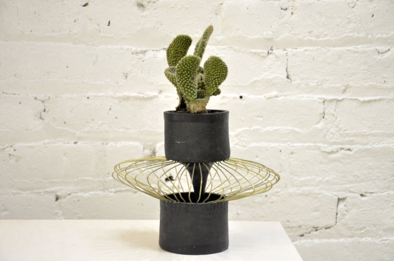 """This is Melissa. Ceramic, leather, brass, cactus. 10 1/2"""" x 9"""" x 9"""". $500. Water once per month lightly.  SOLD"""