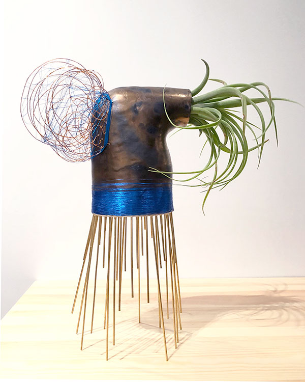 """This is Tish. Ceramic, brass wire, thread, tillandsia. 17.5"""" x 13"""" x 7"""". $2300. Spray plant with water twice per week."""