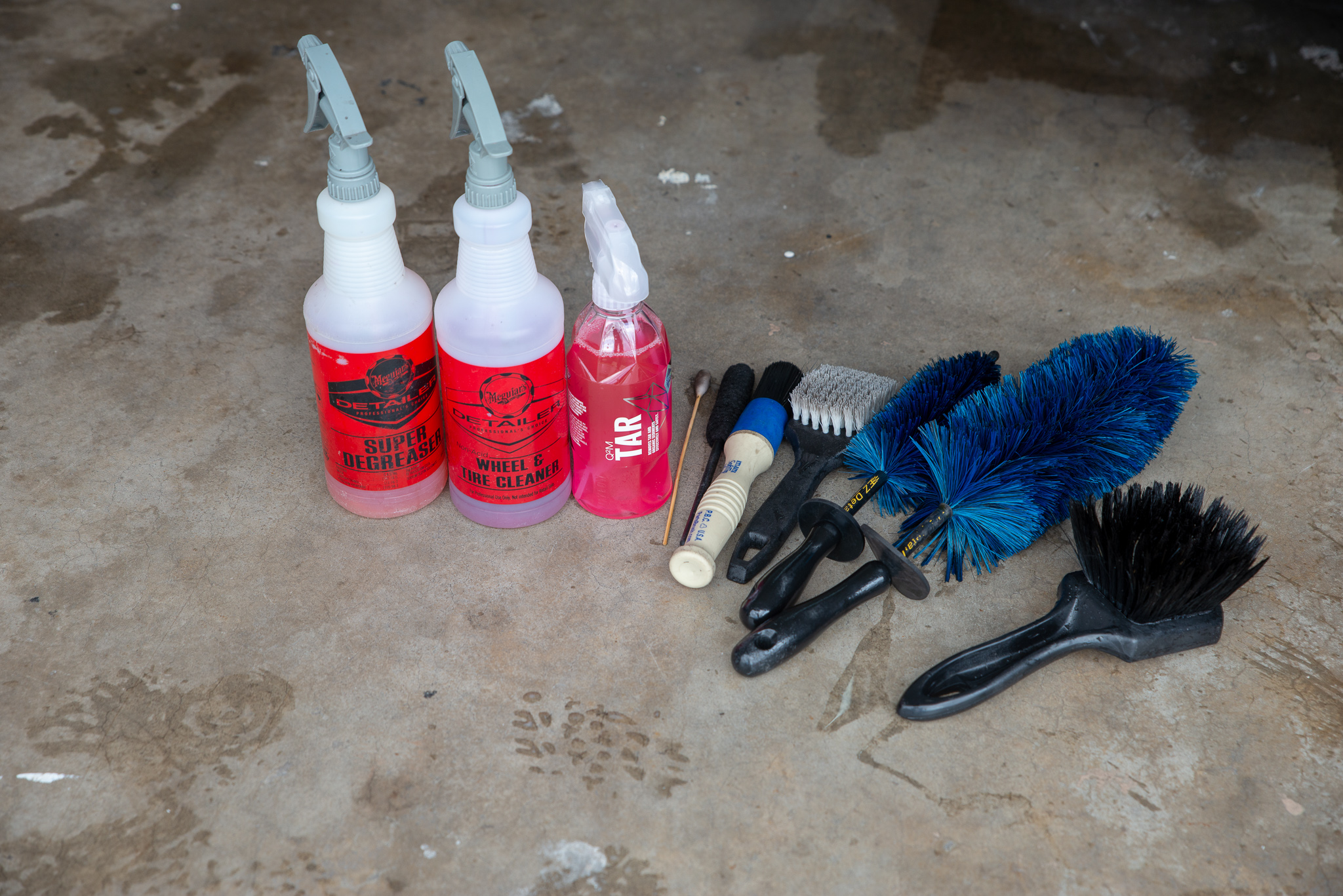 Meguiar's Super Degreaser and Wheel and Tire Cleaner, Gyeon Tar Remover, and a variety of brushes