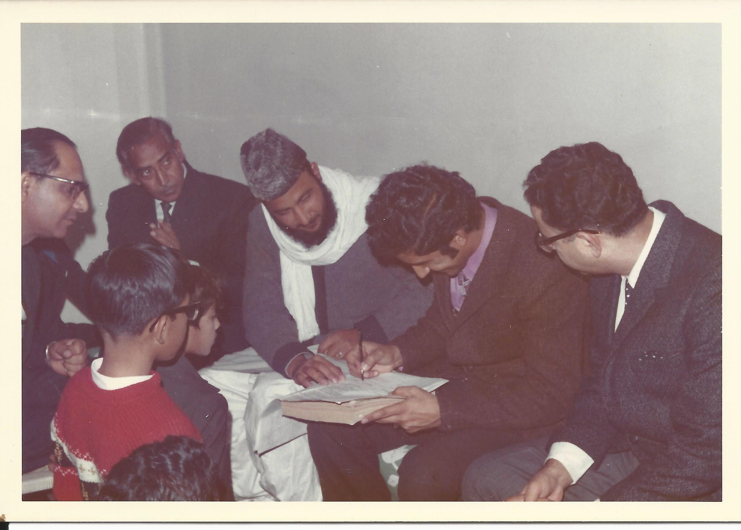 In a separate room, my husband signs the marriage contract