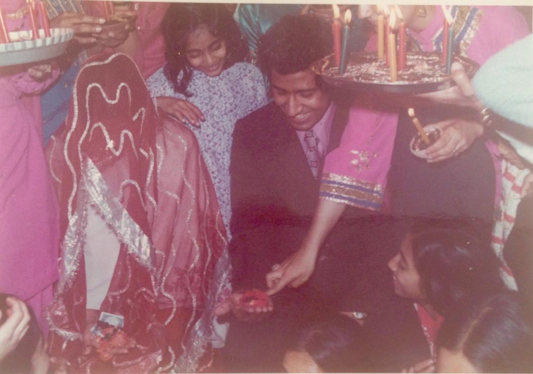 Mehndi: henna ceremony. Draped in a veil.