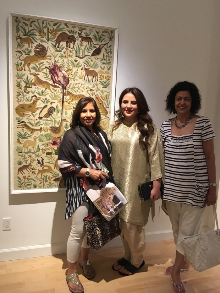 Marium Agha, center, at her exhibit at Artifact Gallery in New York City