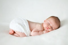 sleeping-newborn-baby-blanket-59033149.jpg