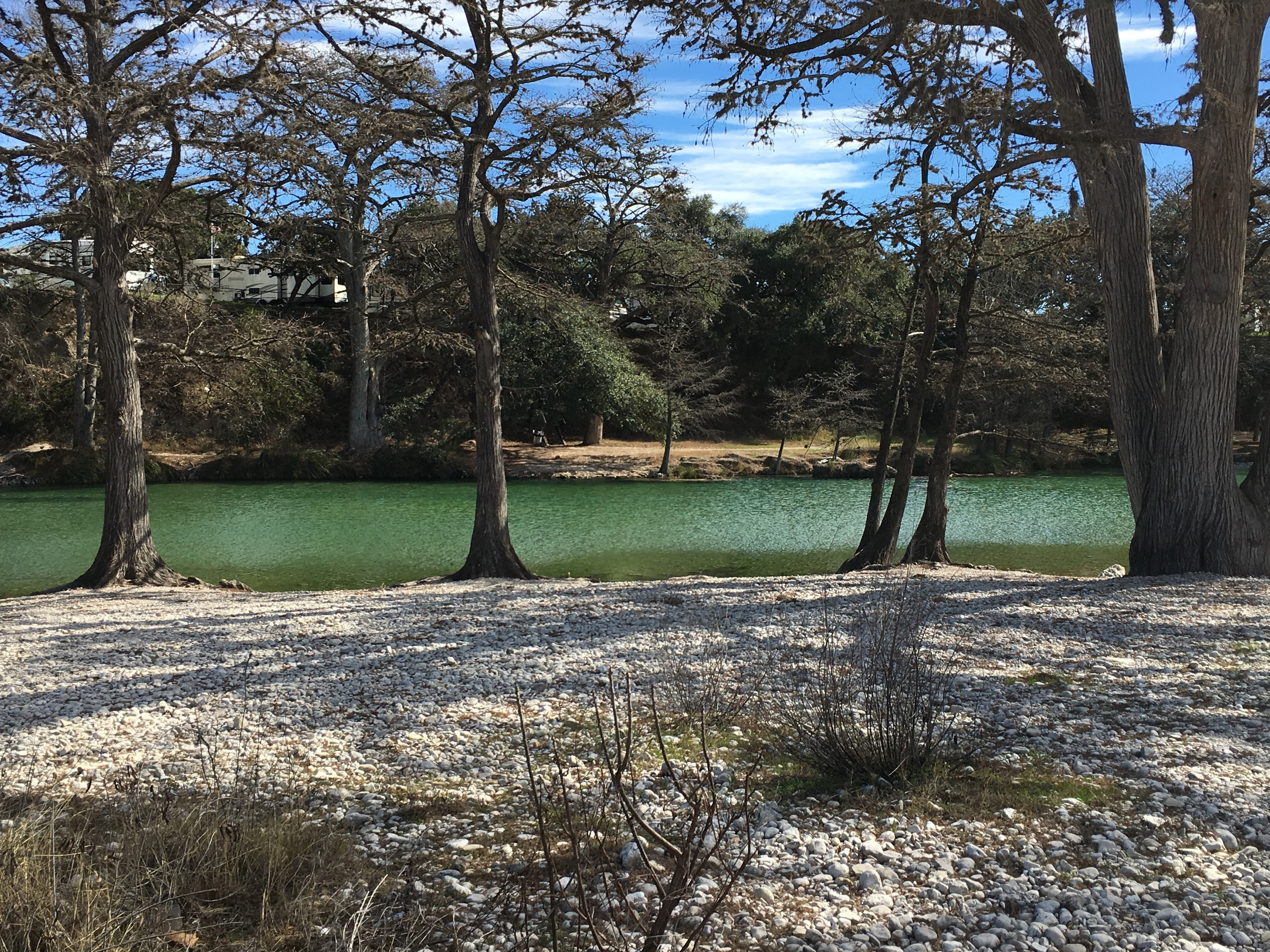 The waters of the Rio Frio are crystal clear and emerald green.
