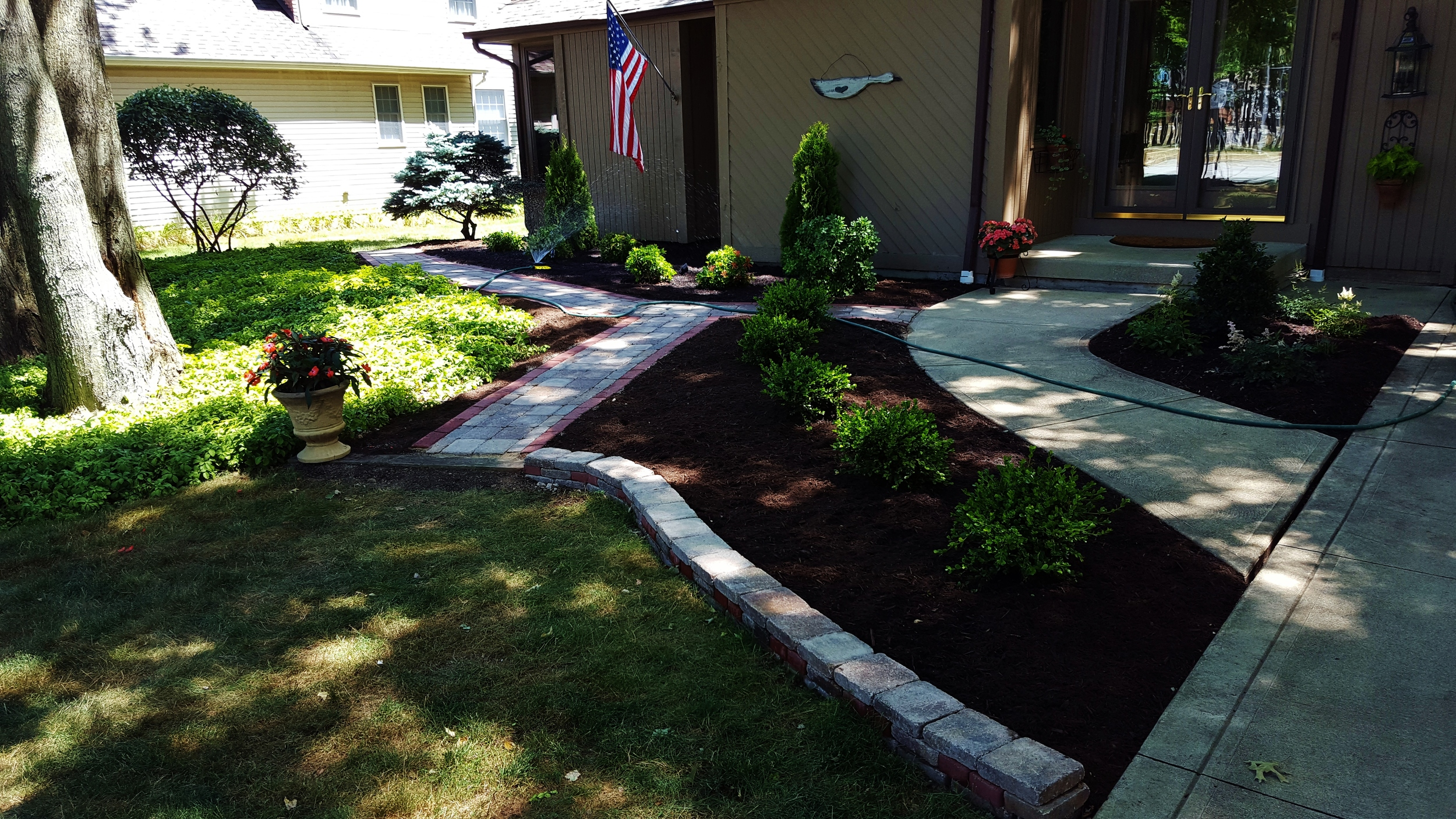 Landscape design and implementation.  Included paved walkway and retaining wall.