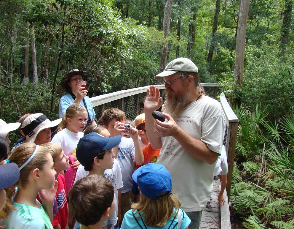 GLH teaching participants about common musk turtles ( Sternotherus odoratus ) during a Brooker Creek Preserve Herpetology Camp (photograph by Deborah Theisen)