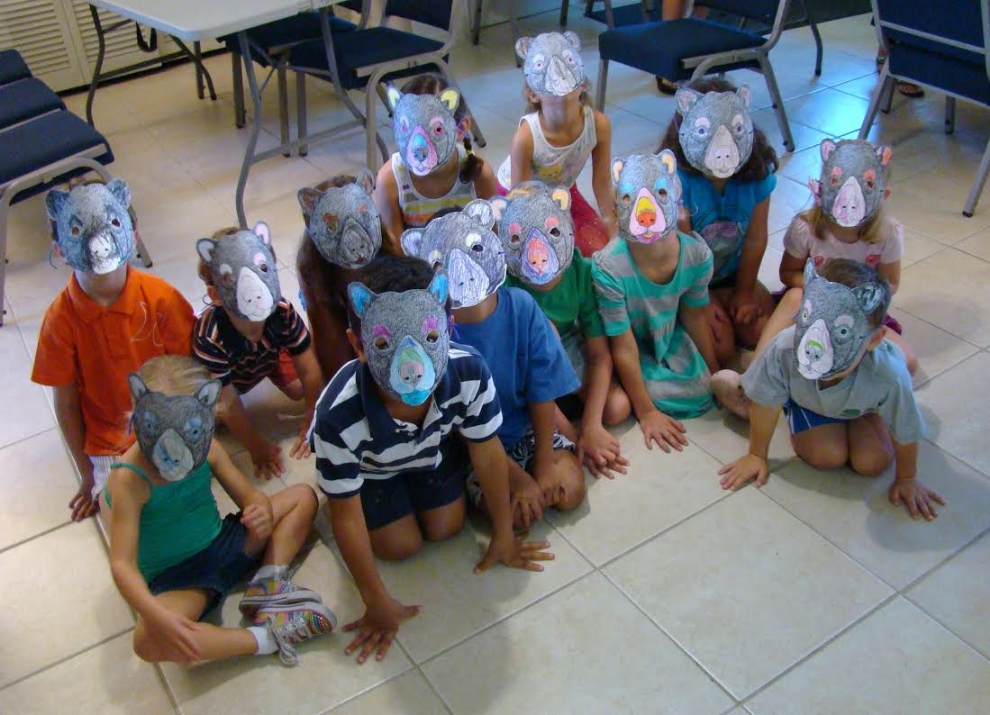 Students wearing bear masks that they created during a lesson on Florida black bear ecology and conservation (photograph by GLH)