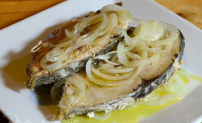 Traditional Puerto Rican escabeche using Kingfish steaks. Add capers for zing!