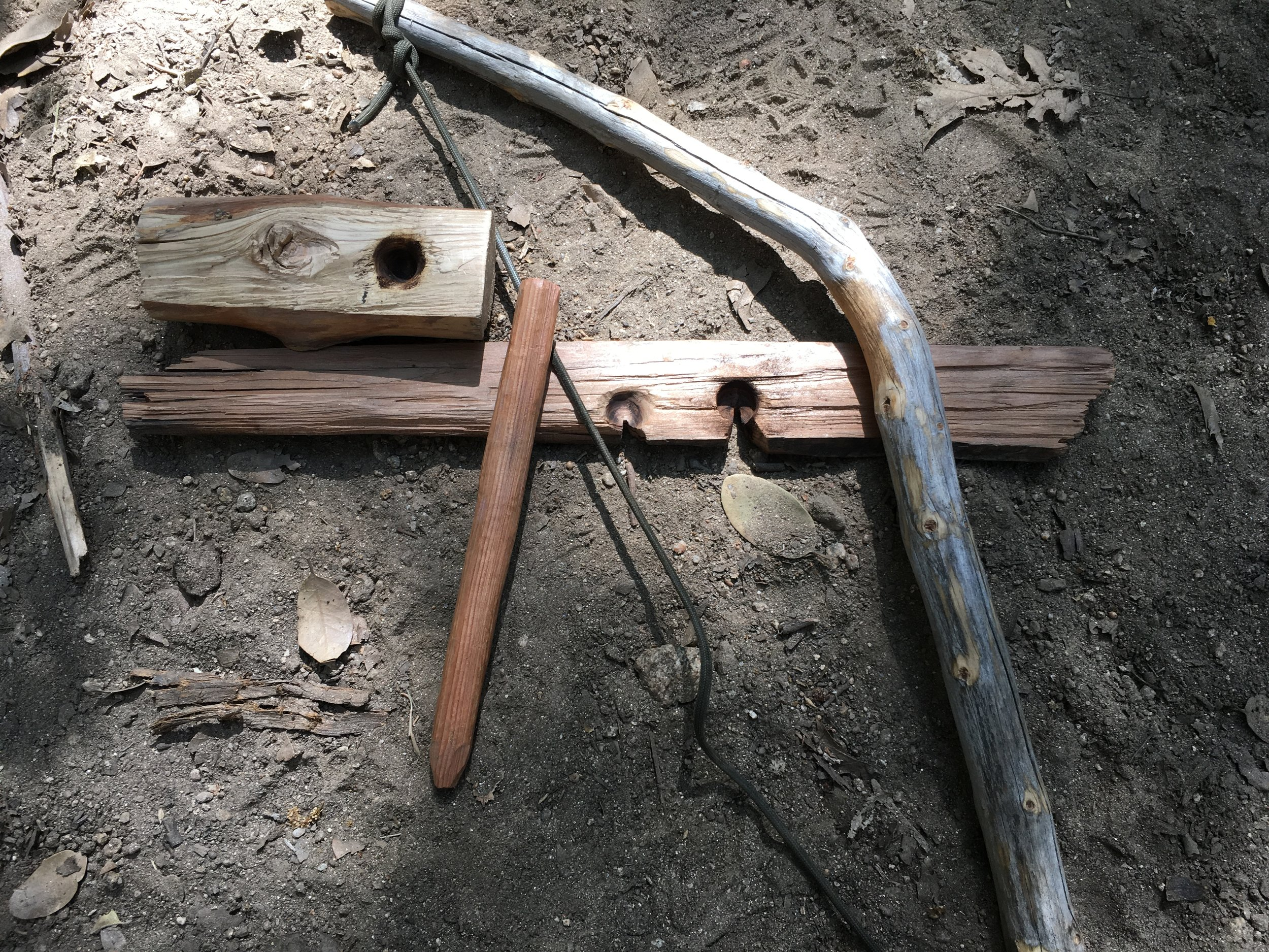 A hand made cedar wood Bow Drill friction fire kit by a student at Bush Survival Training.