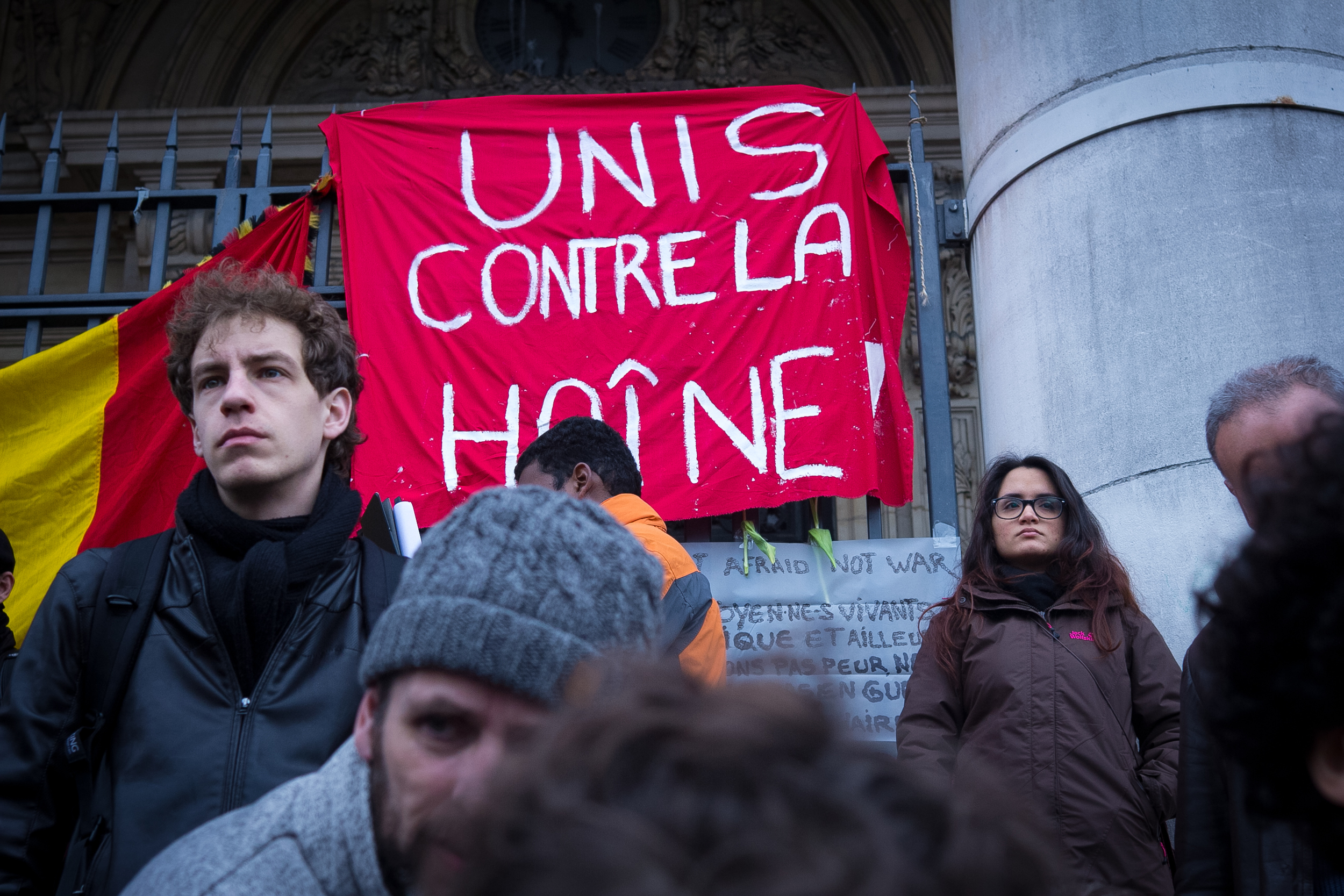 """A gathering in Belgium, and a sign that reads """"united against hate."""" (Flickr - Valentina Cala)"""