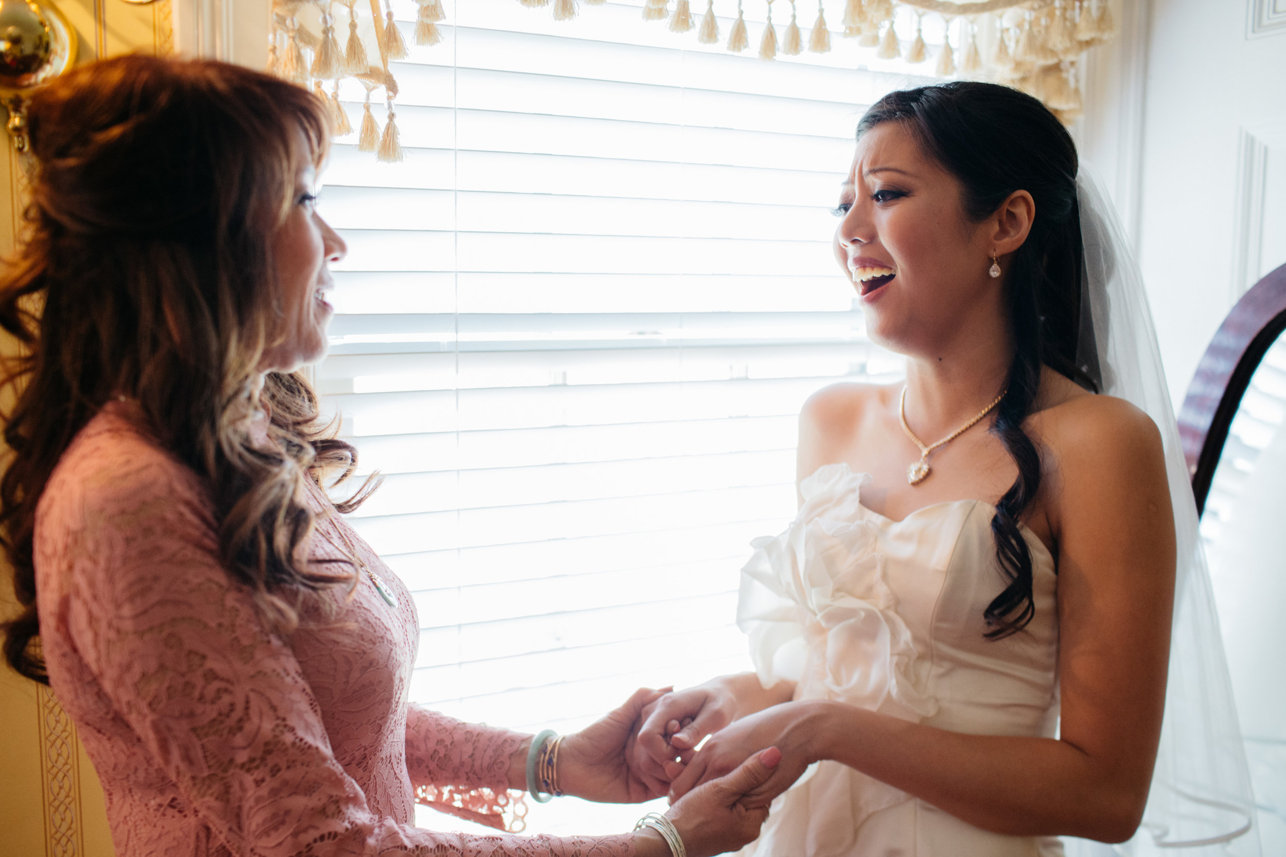 The mother talks to her daughter, few minutes before the wedding ceremony.