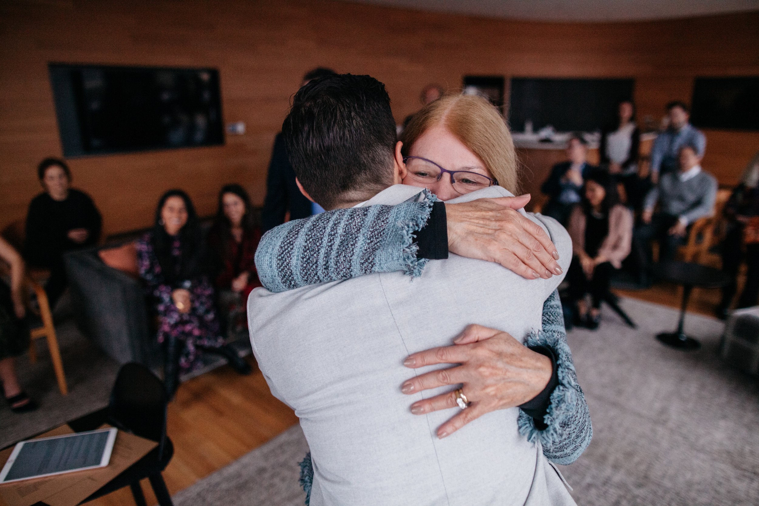 The mother of the groom hugs her son