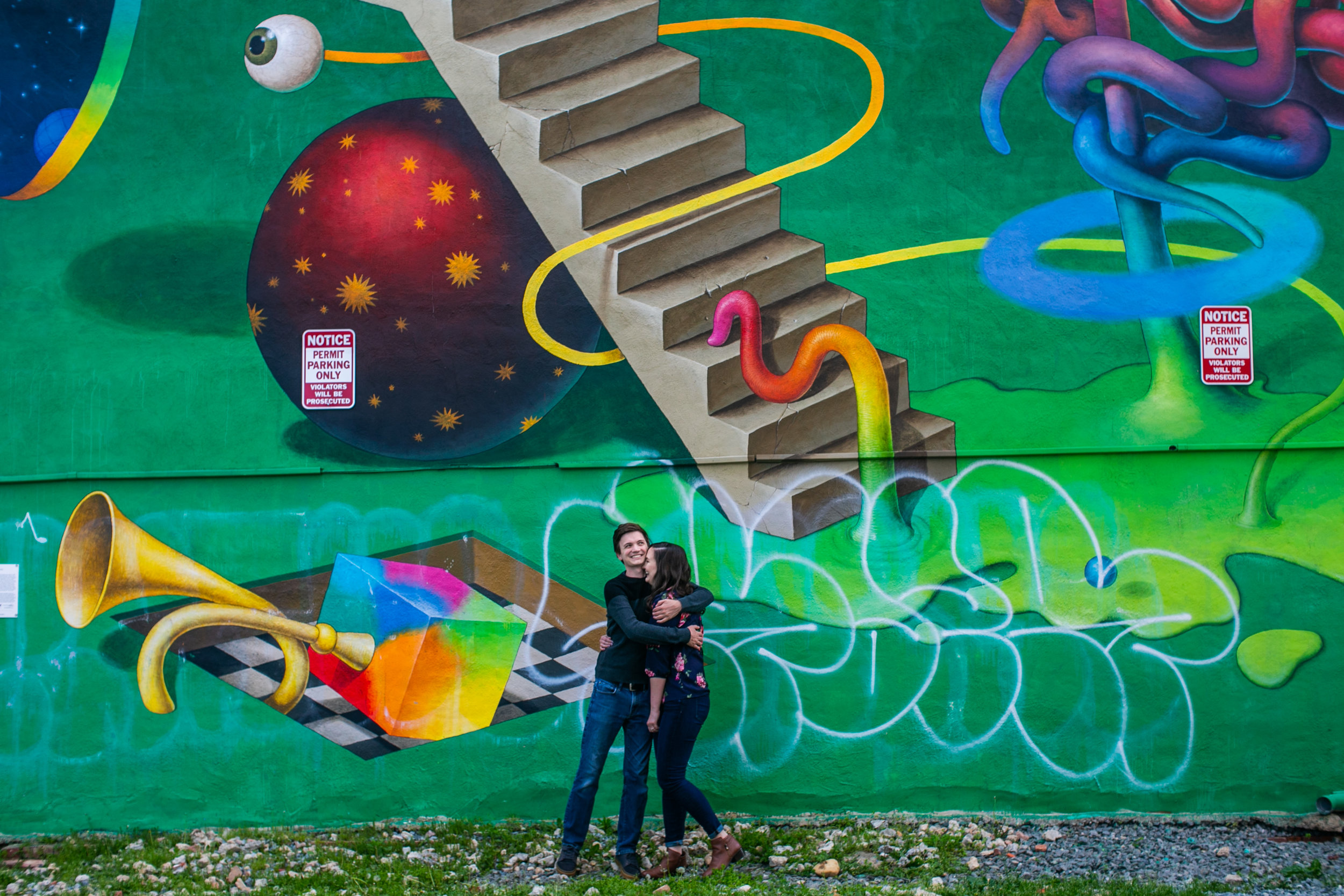 Engagement session in front of a mural in Washington DC