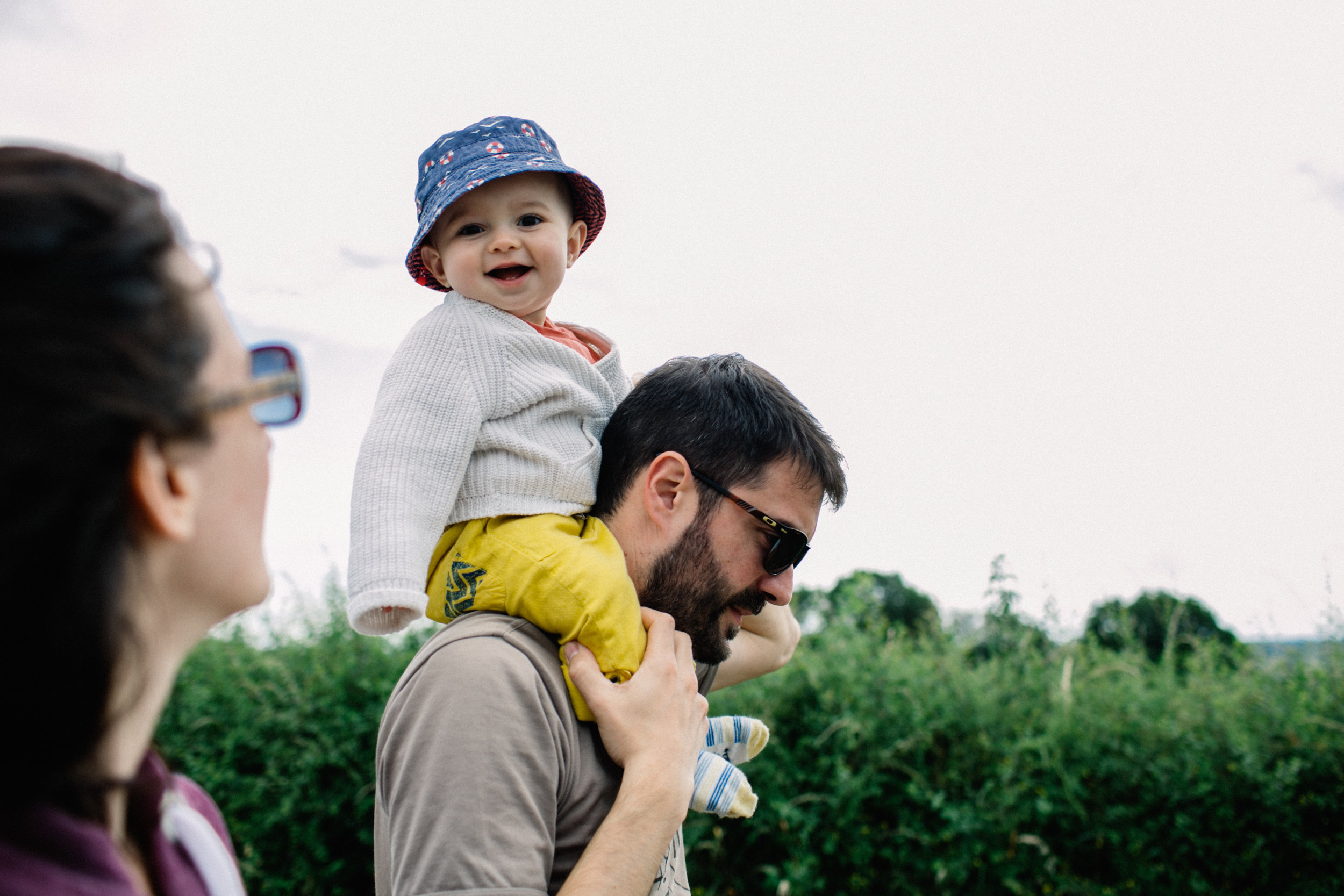 Baby Camille on his dad's shoulders during a small walk.