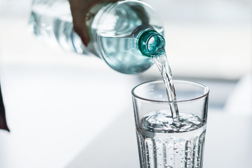 pouring-water-from-pet-bottle-into-a-glass-picjumbo-com-1024x683.jpg