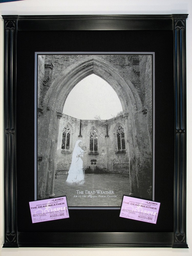 Tabernacle frame made to bring out the Gothic arch of the concert poster and tickets.