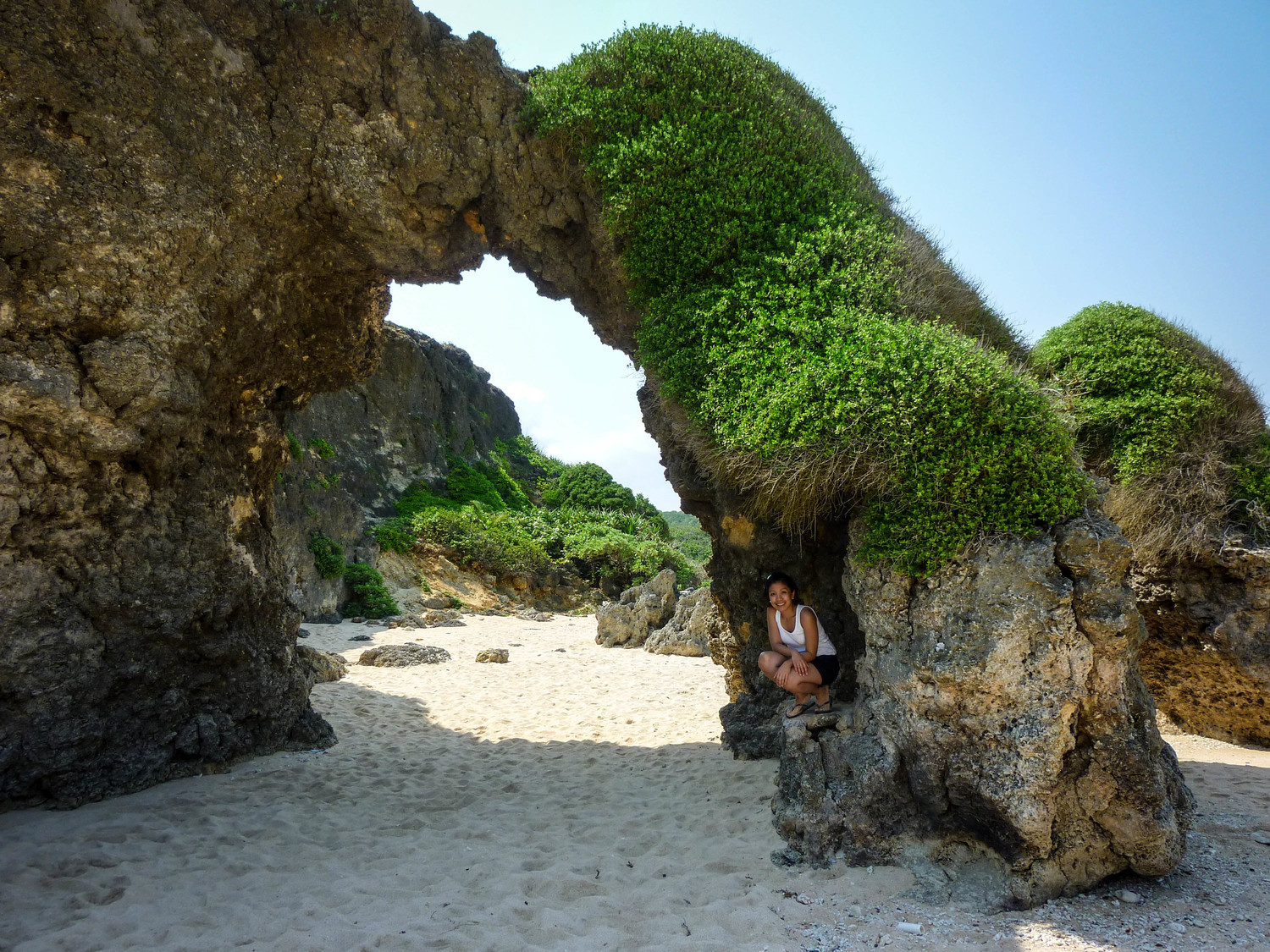 Snap a picture underneath the arch in Sabtang's white beach