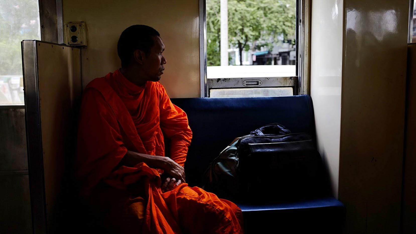A monk on the train. Bangkok. 2017.