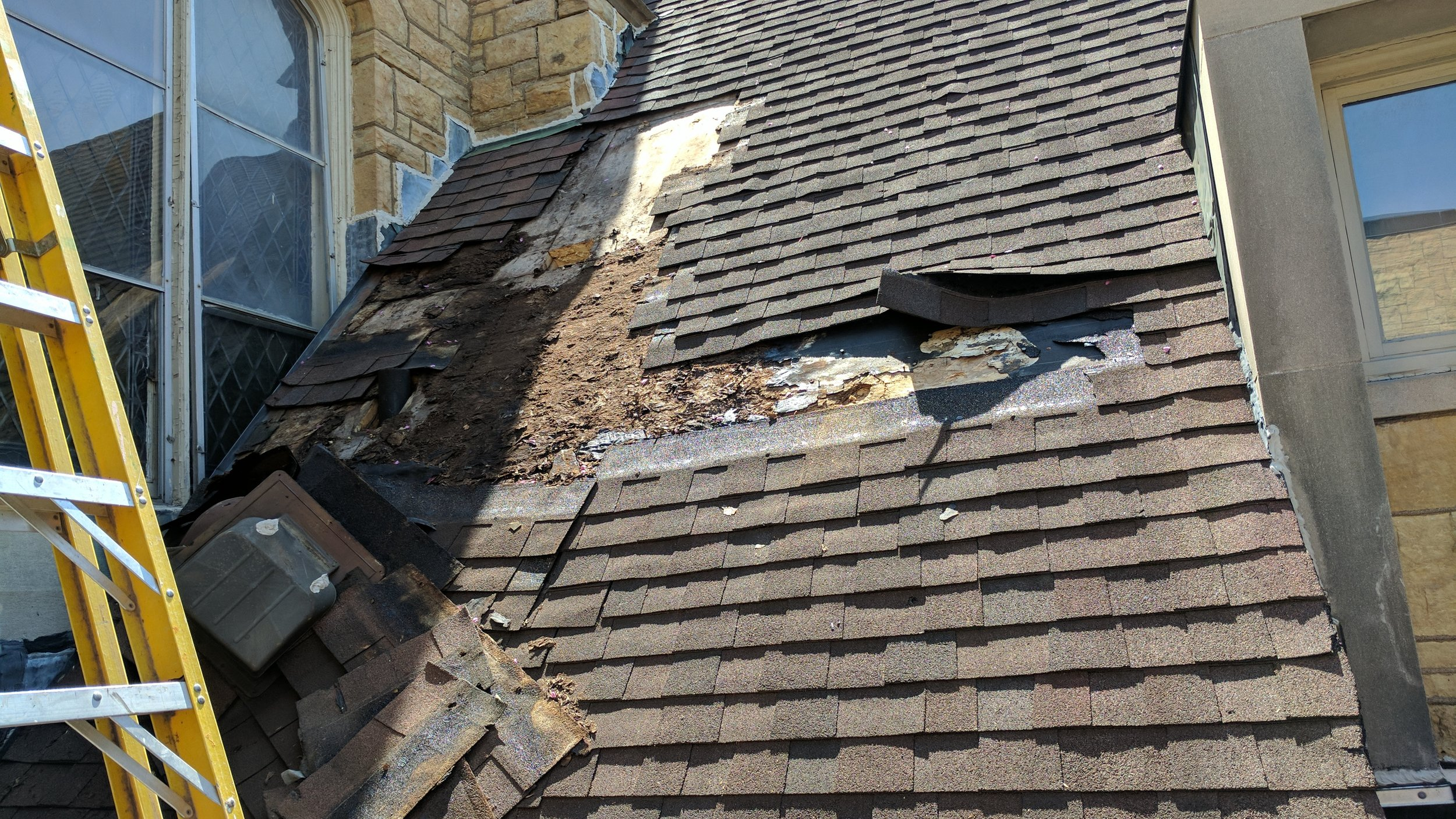 Restoring a section of the roof with water damage.