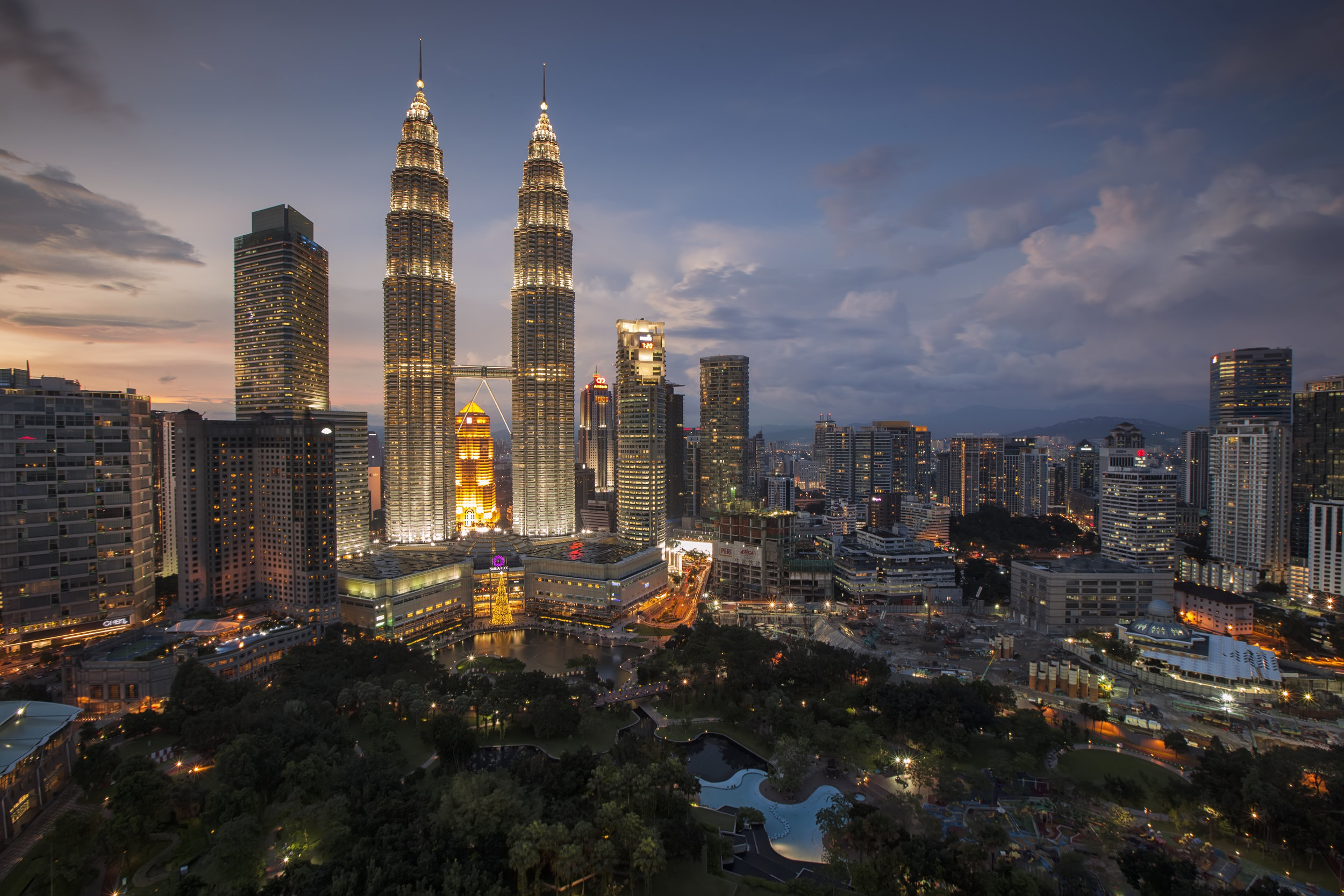 The City of Kuala Lumpur, popularly named KL, has the last decade become one of the most vital cities in Asia. KL is Malaysia's sultry capital packed with historic monuments, steel-clad skyscrapers, lush parks, mega-sized shopping malls, bustling street markets and trendy nightspots. Also an essential part of the vibrant mix are incense-wreathed, colourfully adorned mosques and temples of the country's Malay, Chinese and Indian communities. A reverence for these ancient cultures is balanced with a drive to be plugged into the contemporary world, as evidenced by an exciting contemporary art and design scene and a buzzing digital economy.