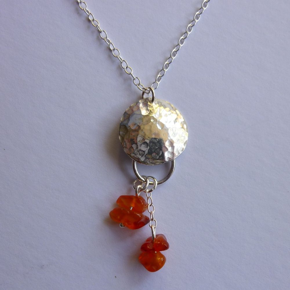 silver hammered domed disc necklace with carnelian drop