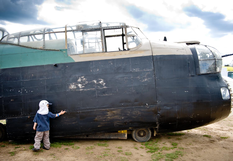 Boy admiring WW2 bomber, War and Peace Show, Kent
