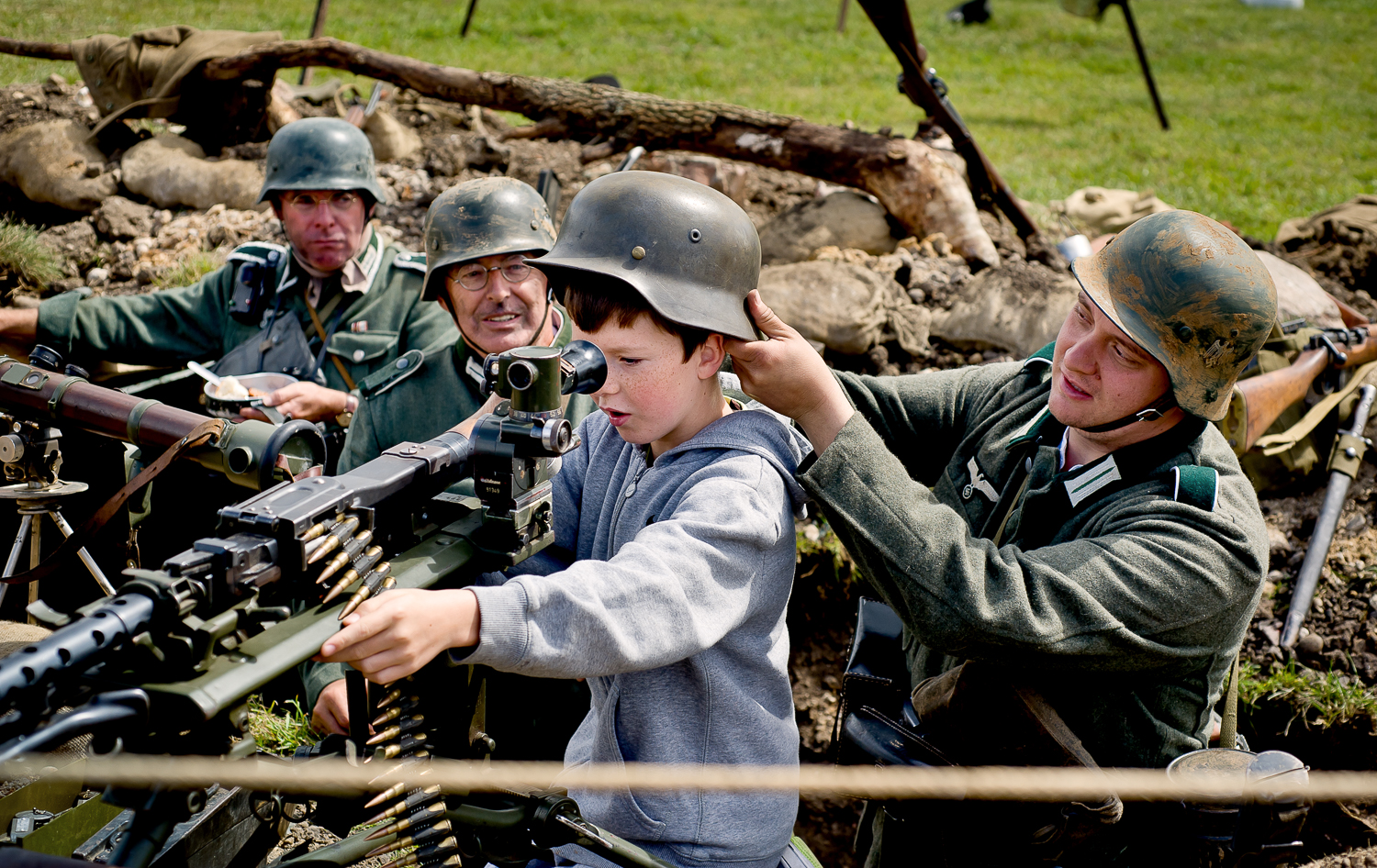 young visitor invited into machine gun post, Re-enactment event in Essex