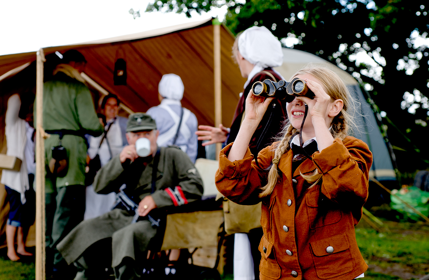 Young re-enactor following planes participating in an airshow at War and Peace show, Kent
