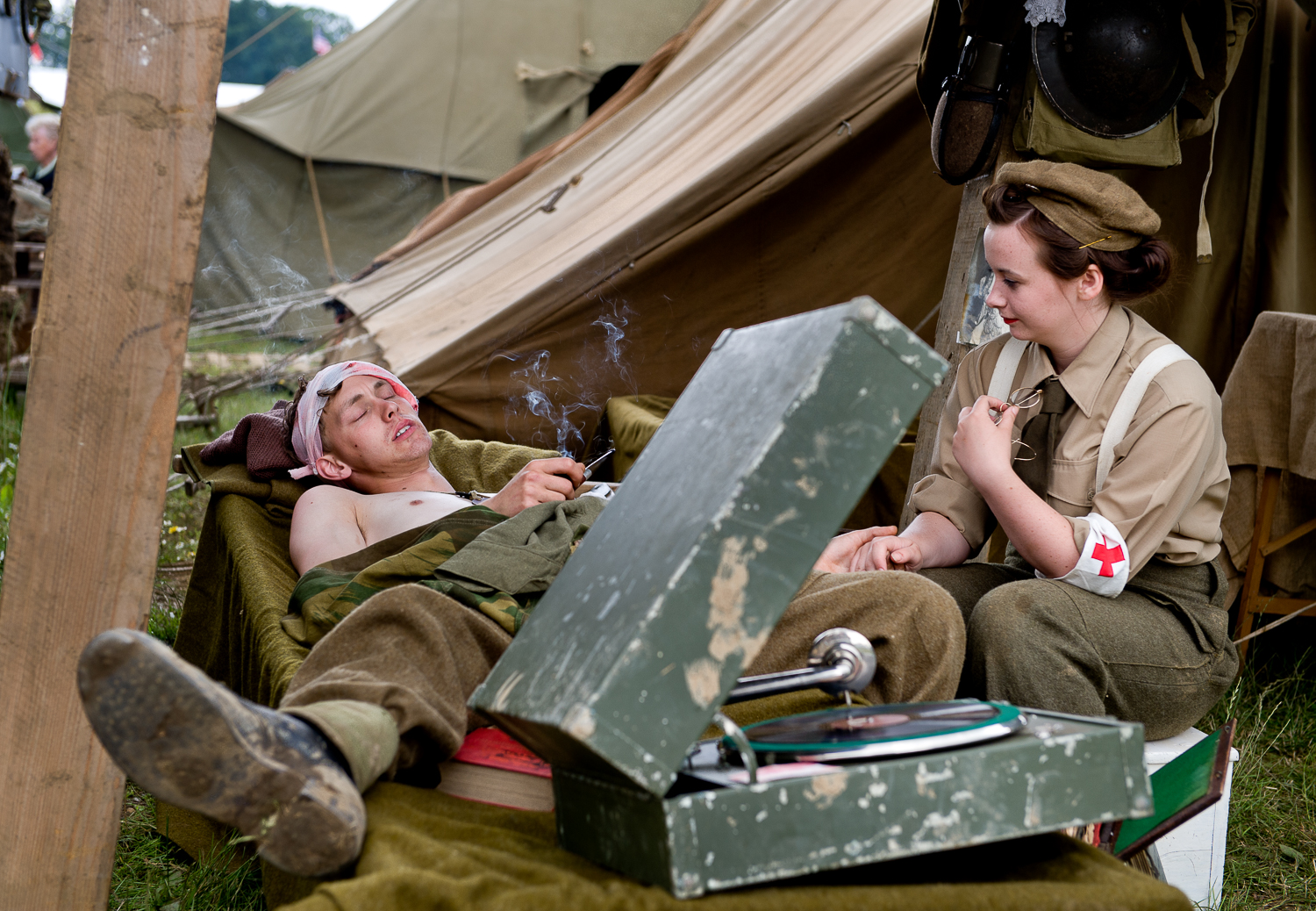 Nurse comforting injured soldier [re-enactors], War and Peace show, Kent