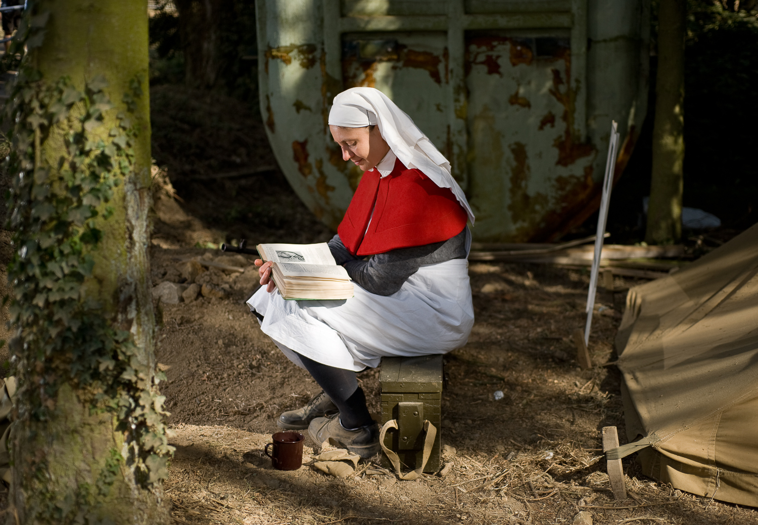 Re-enactor reading in the woods, War and Peace show, Kent