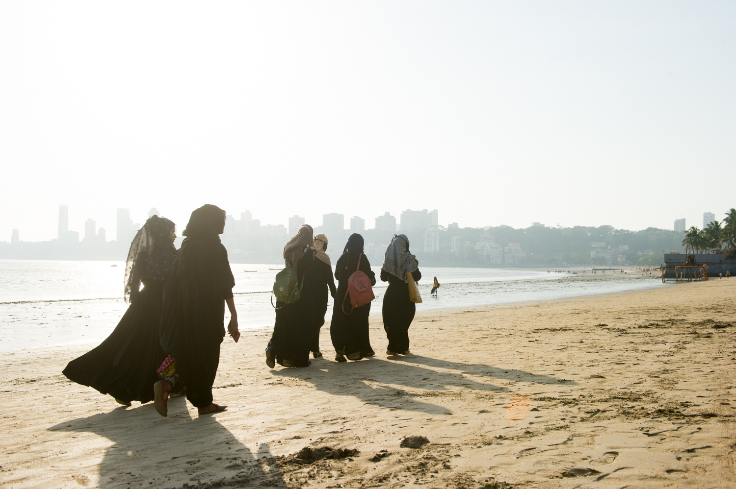 Muslim women taking a walk on the beach, Mumbai, 2019