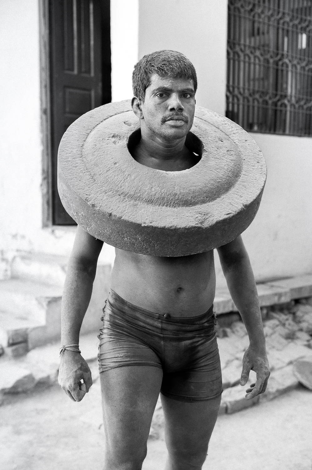 Kushti Wrestler exercising with concrete slab, Varanasi, 2019