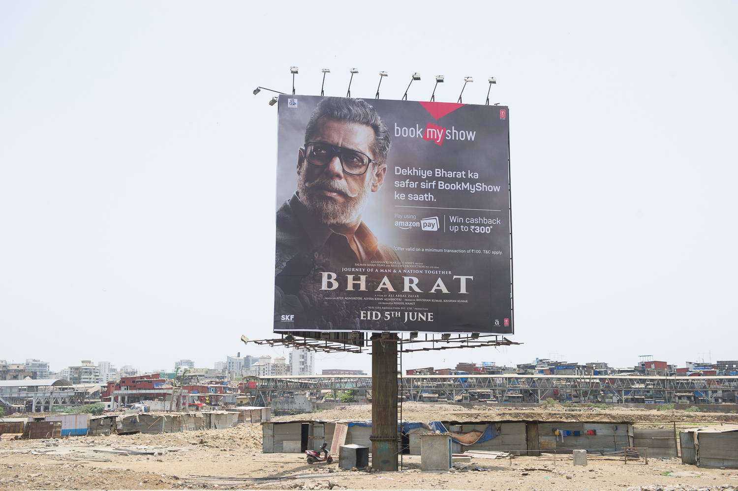 Advertisment Board near Dharavi slums, Mumbai, 2019