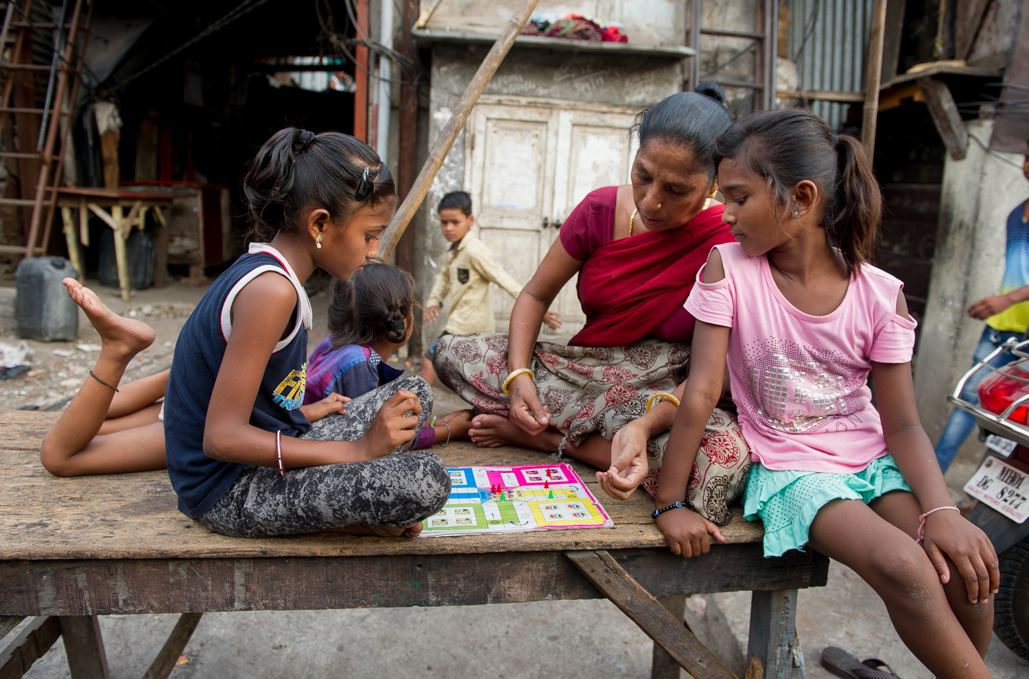 Playing board games, Dhobi ghat, Mahalaxmi, Mumbai, 2019
