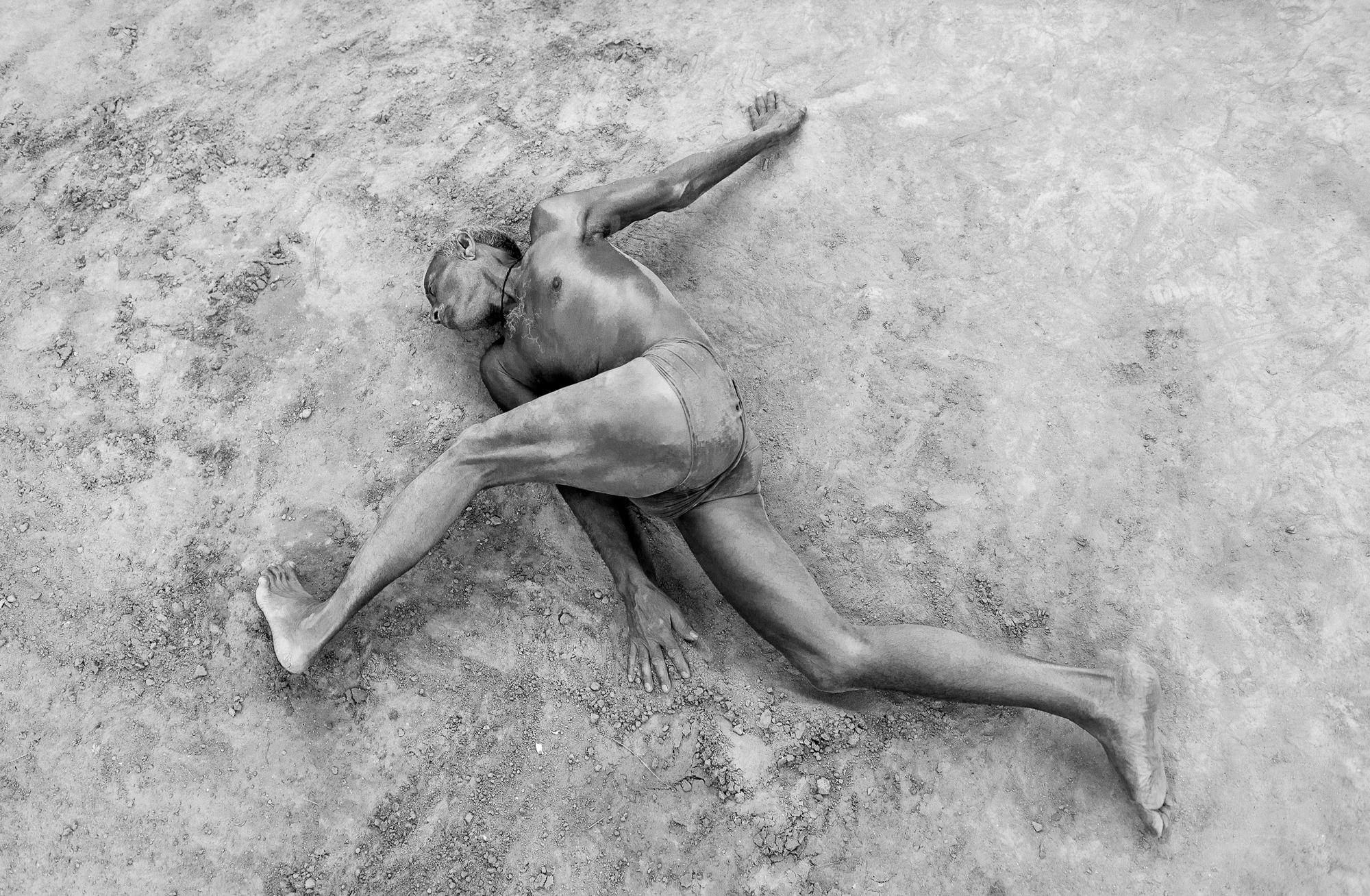 Wrestler stretching, Kushti Akhara, Varanasi, 2019